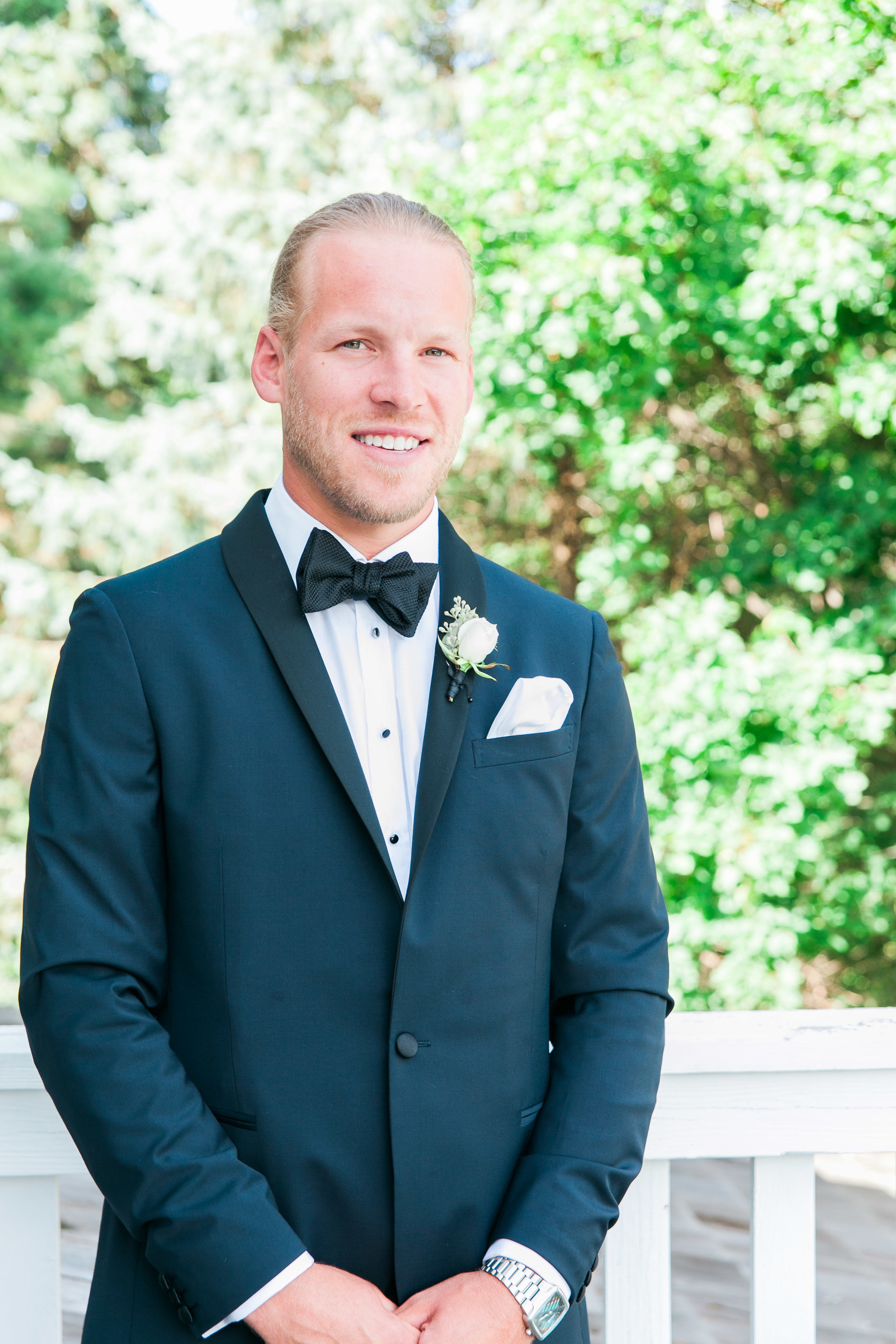 Outdoor portrait of groom in Muskoka