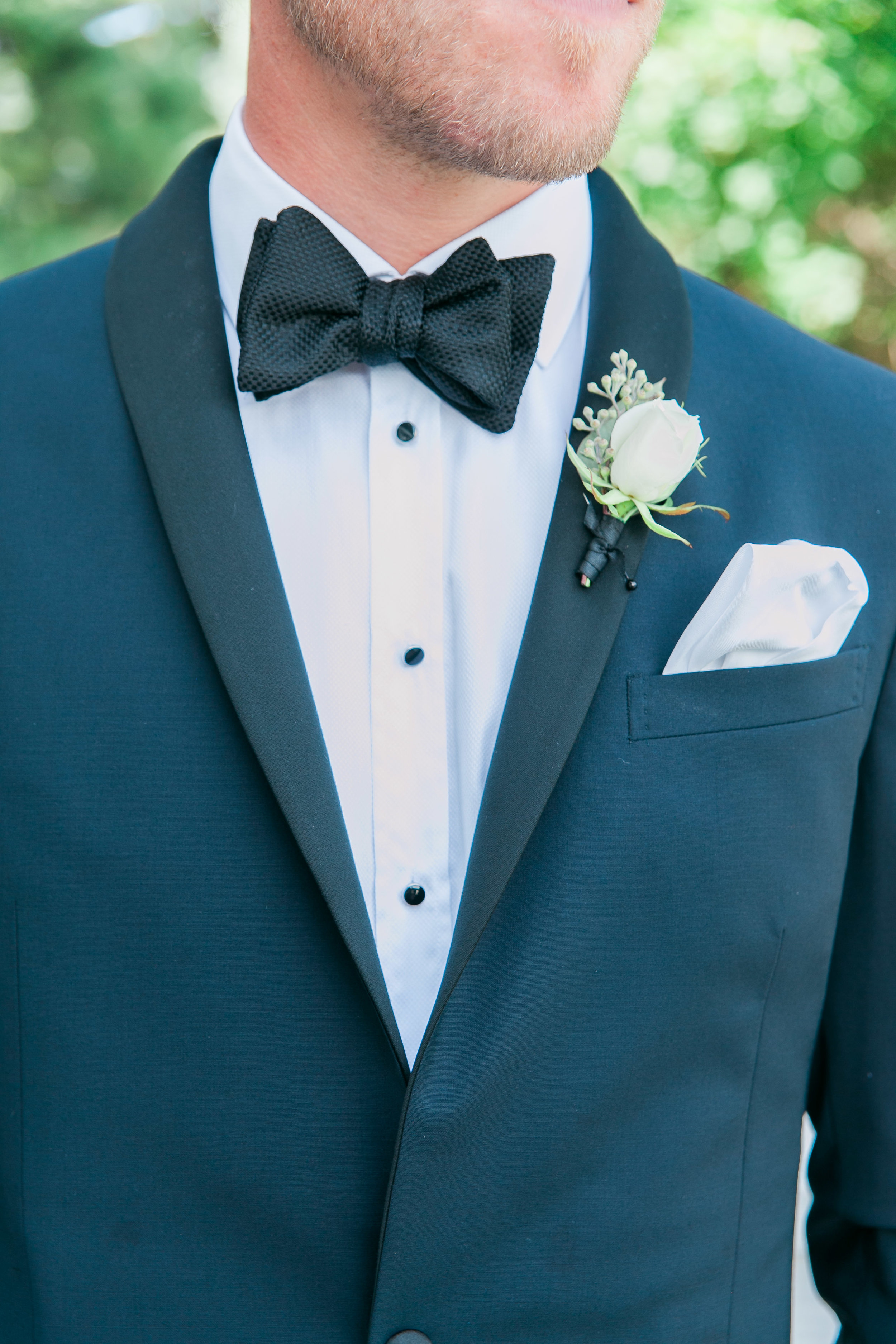 Detail photo of groom's suit