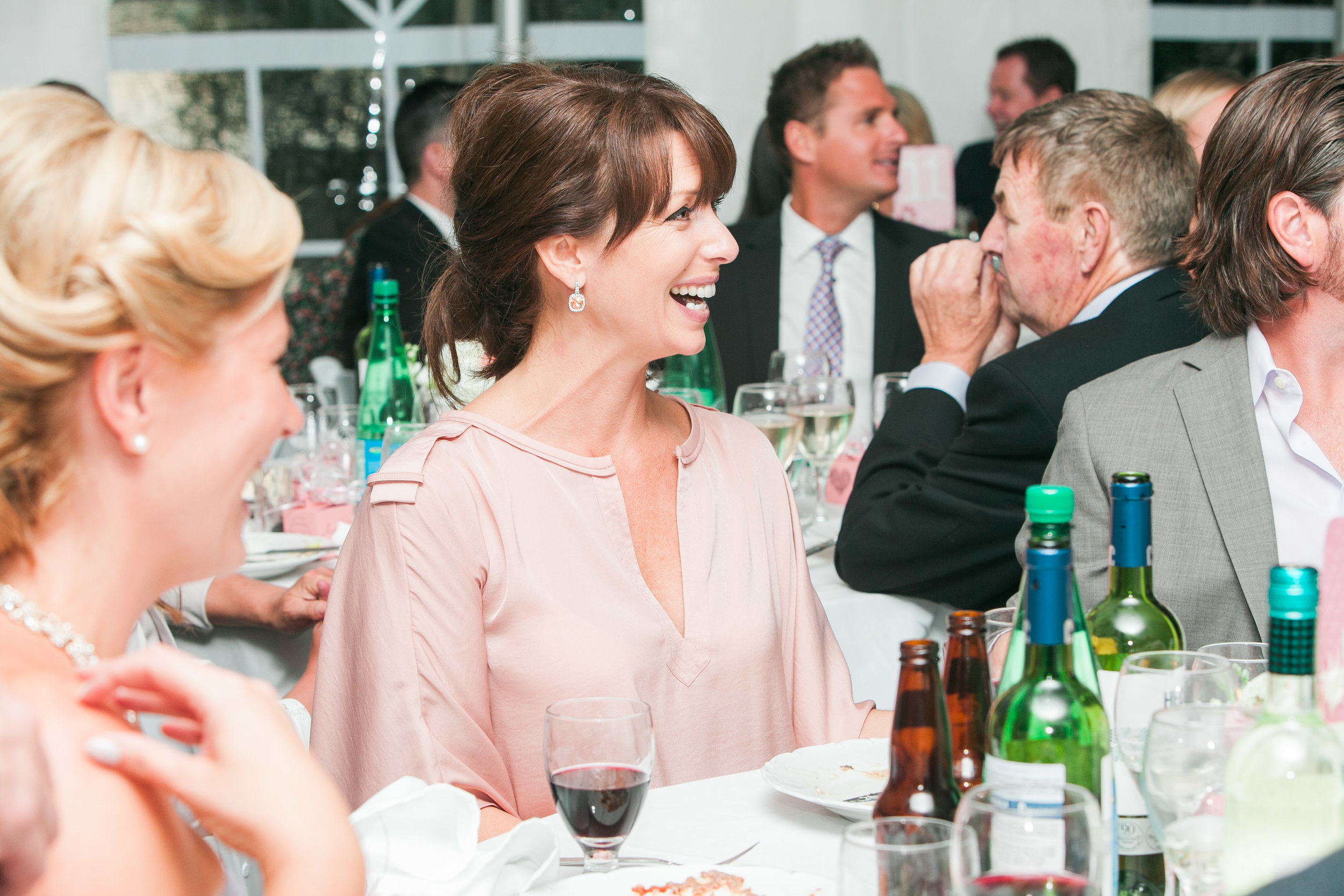 Guest laughing at speeches during dinner
