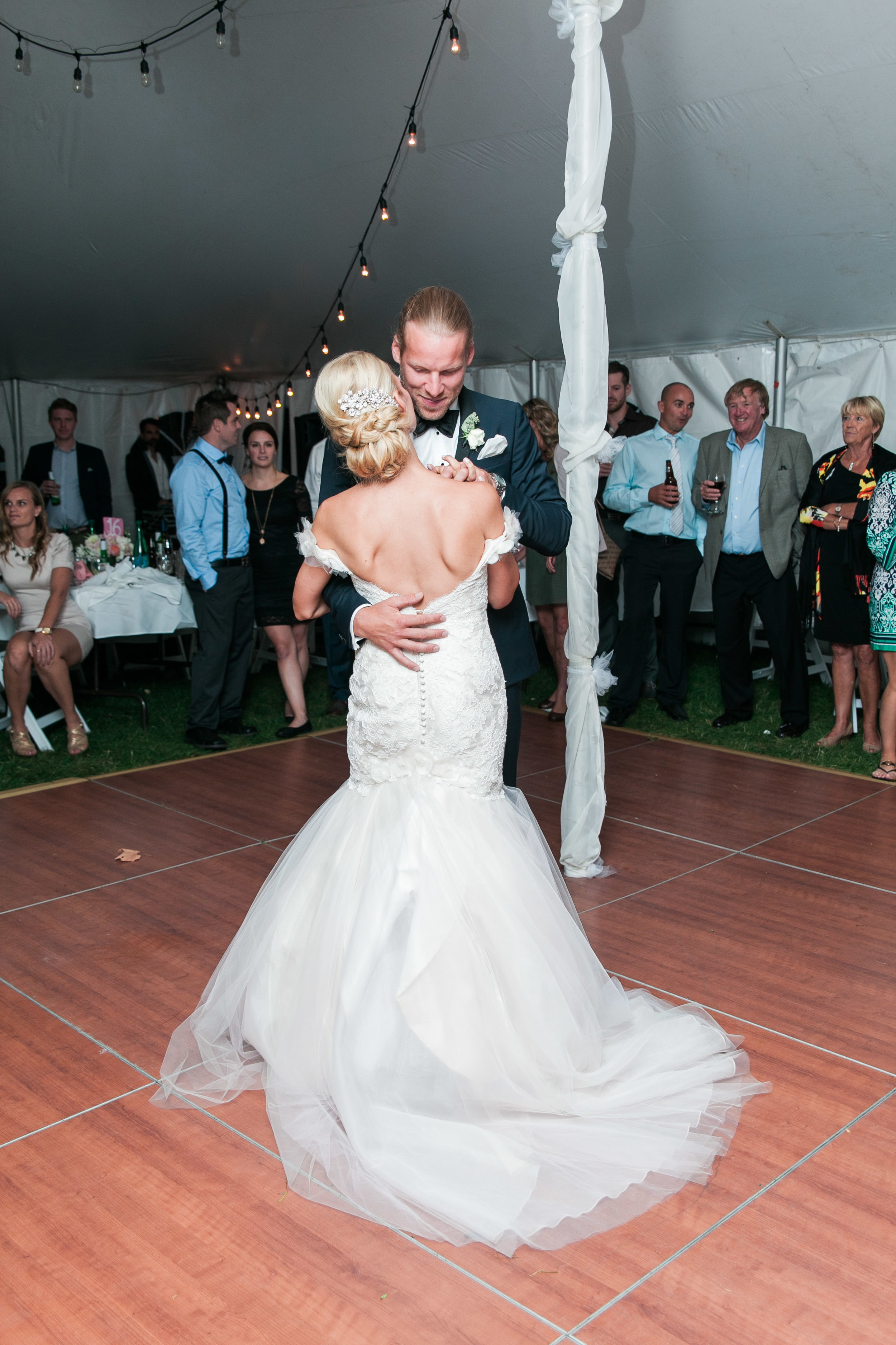 Couple during first dance at tented wedding