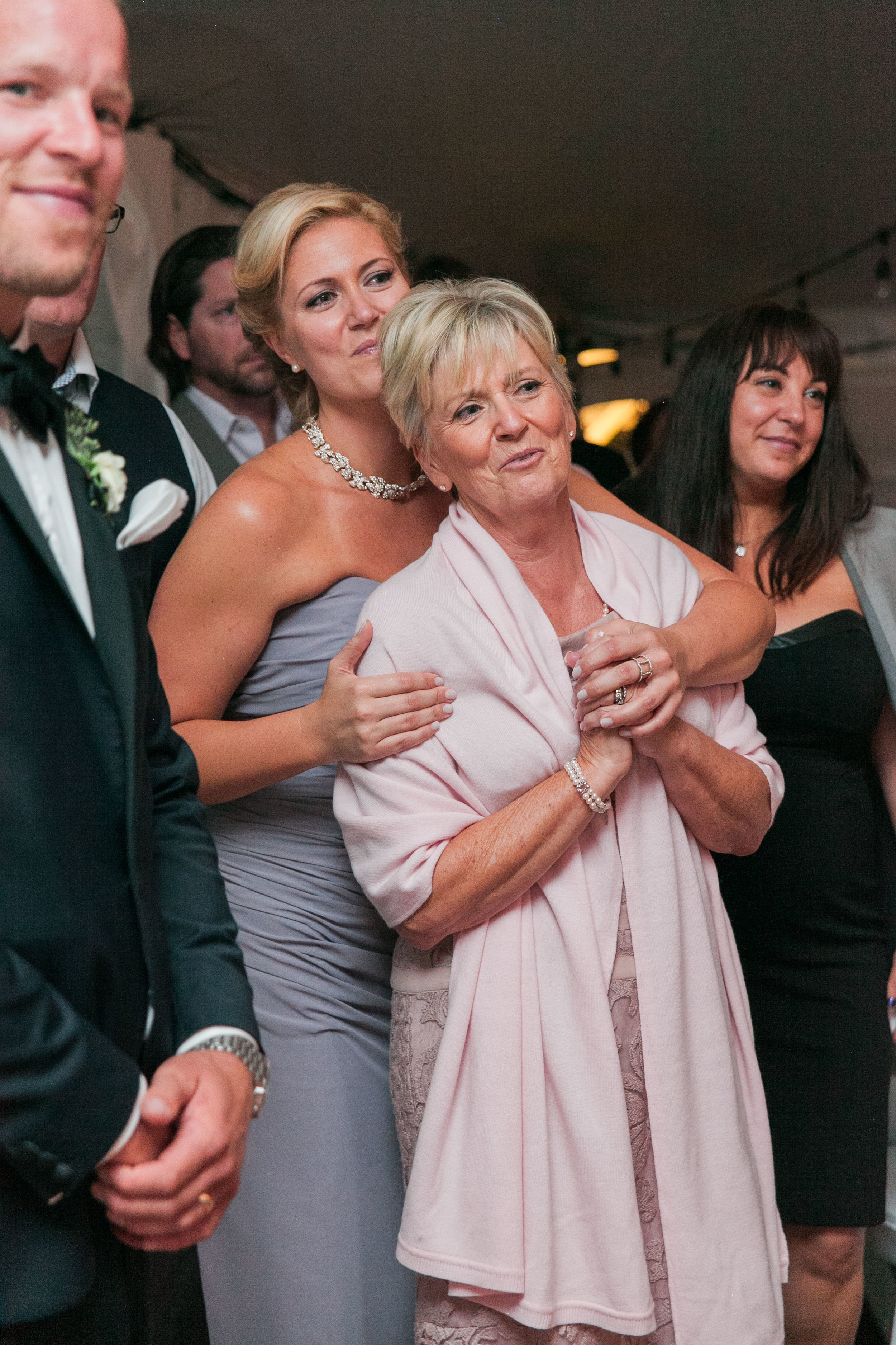 Mother of bride watching father daughter dance
