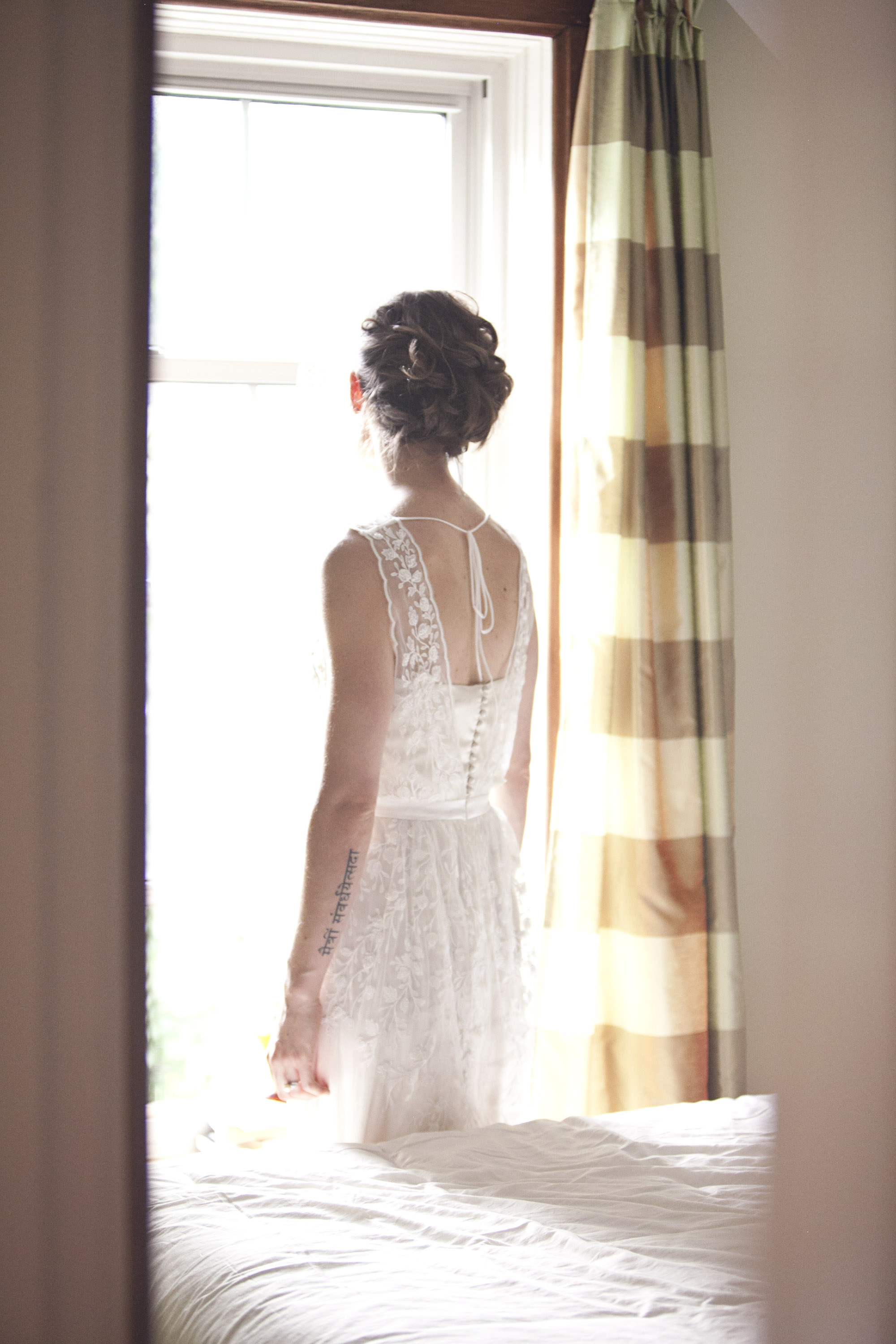 Bride wearing BHLDN floral lace dress