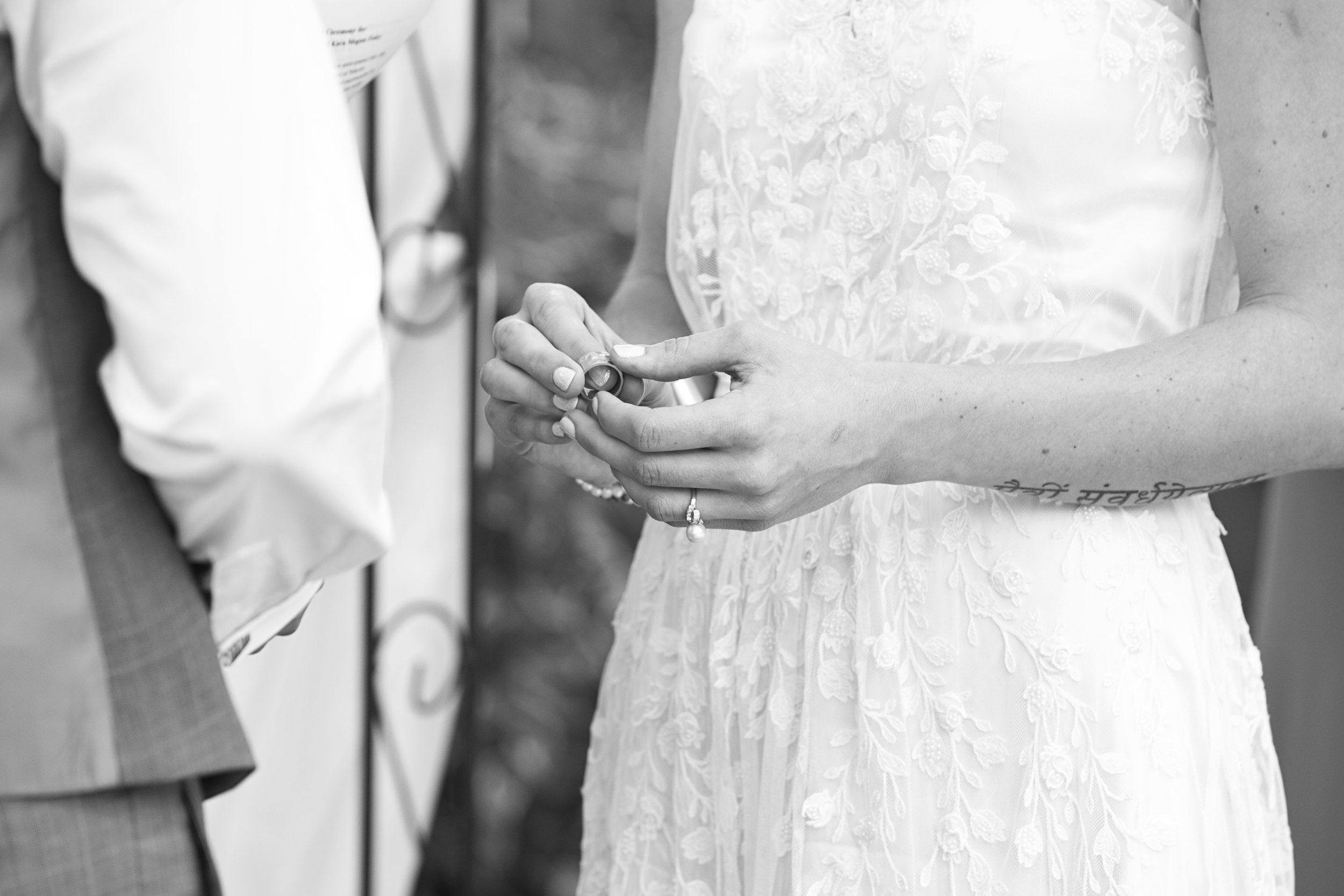 Bride giving groom wedding ring