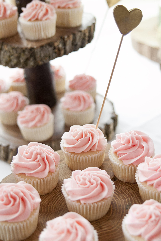 Pink buttercream cupcakes for wedding dessert