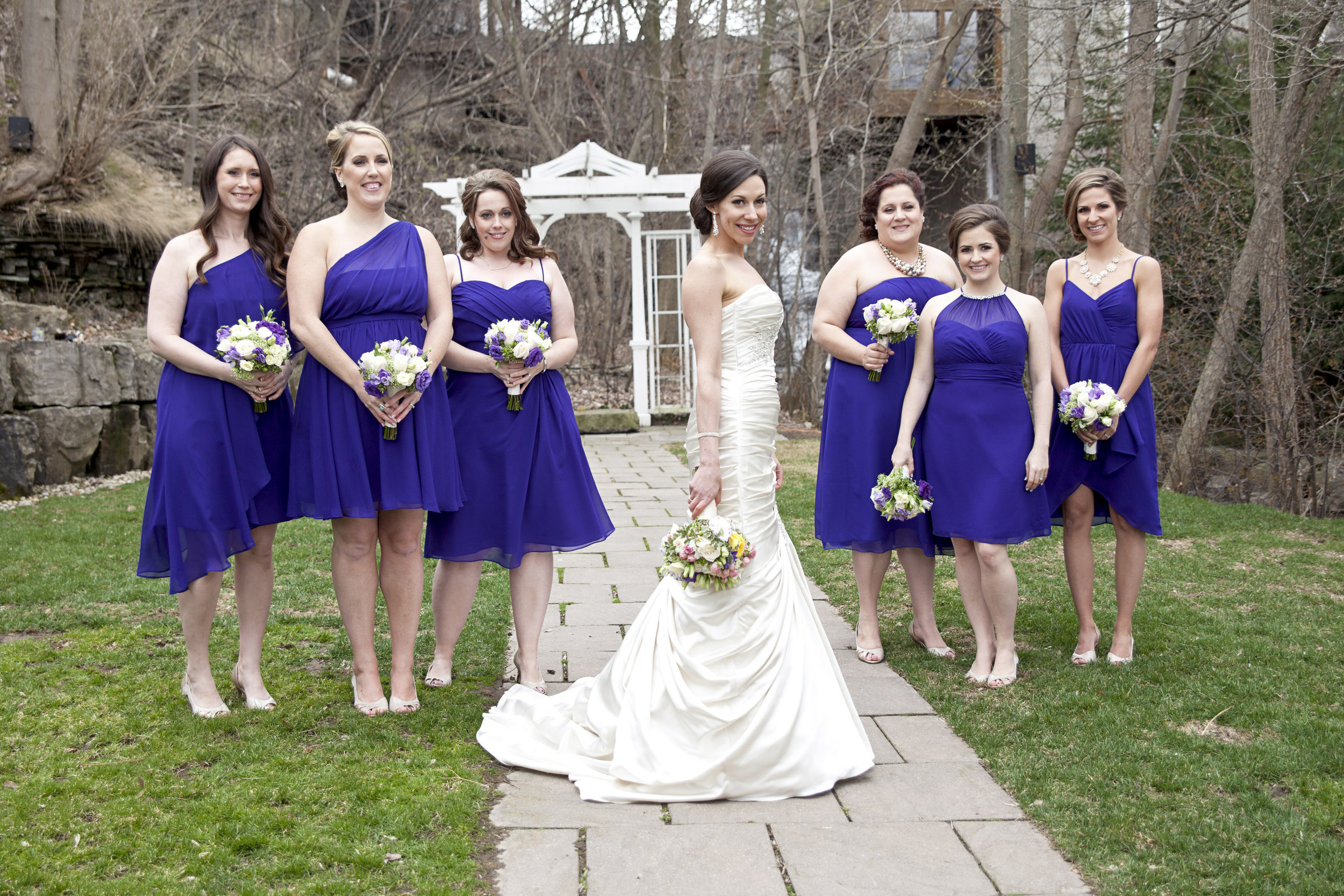 Bridesmaids wearing purple for spring wedding