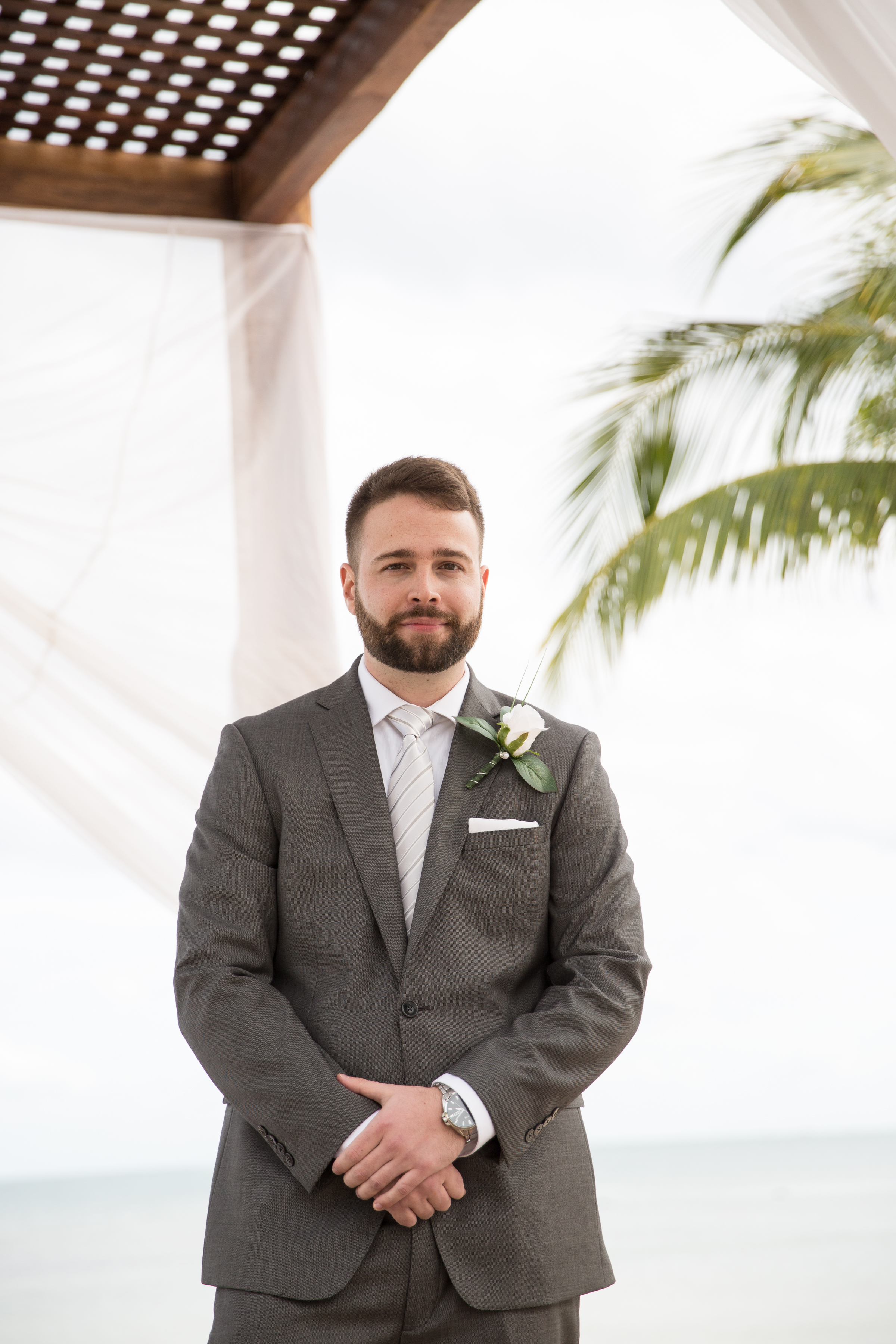 groom at beach ceremony