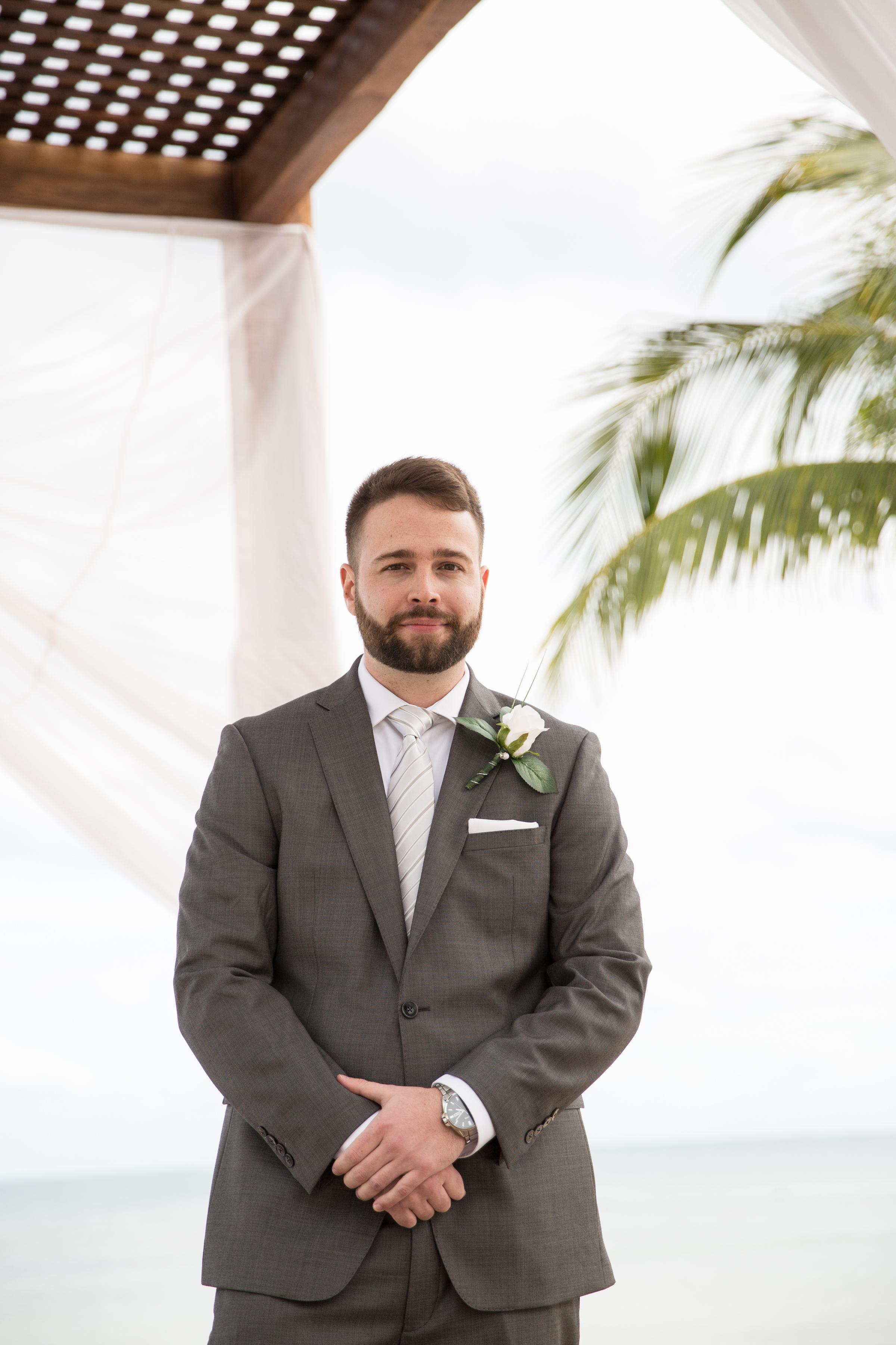 groom at beach ceremony