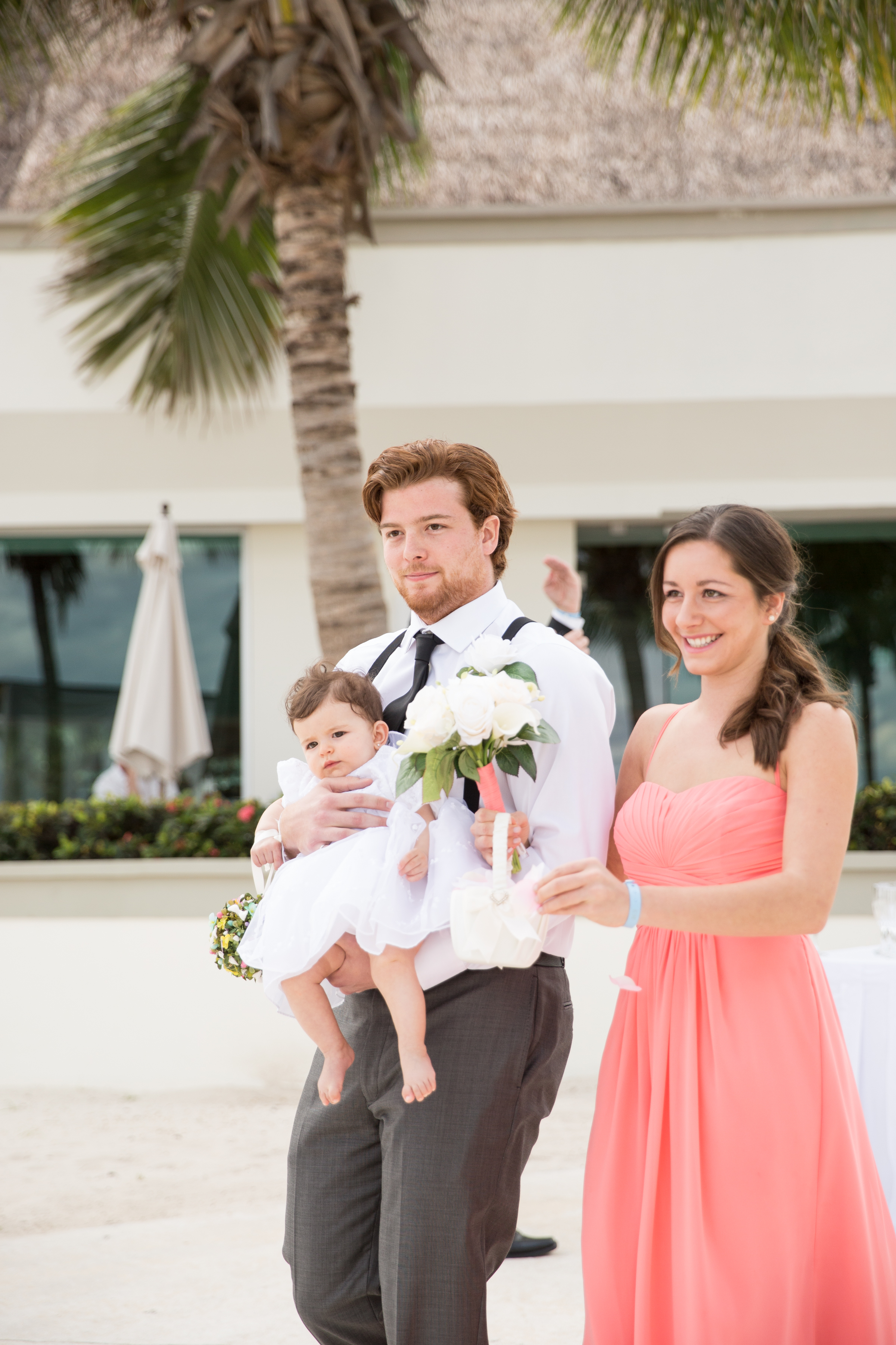 flower girl at beach wedding in mexico