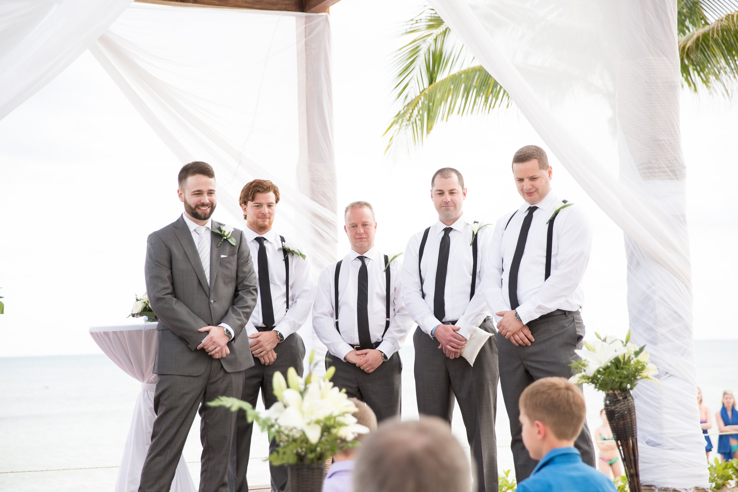groomsmen at beach wedding