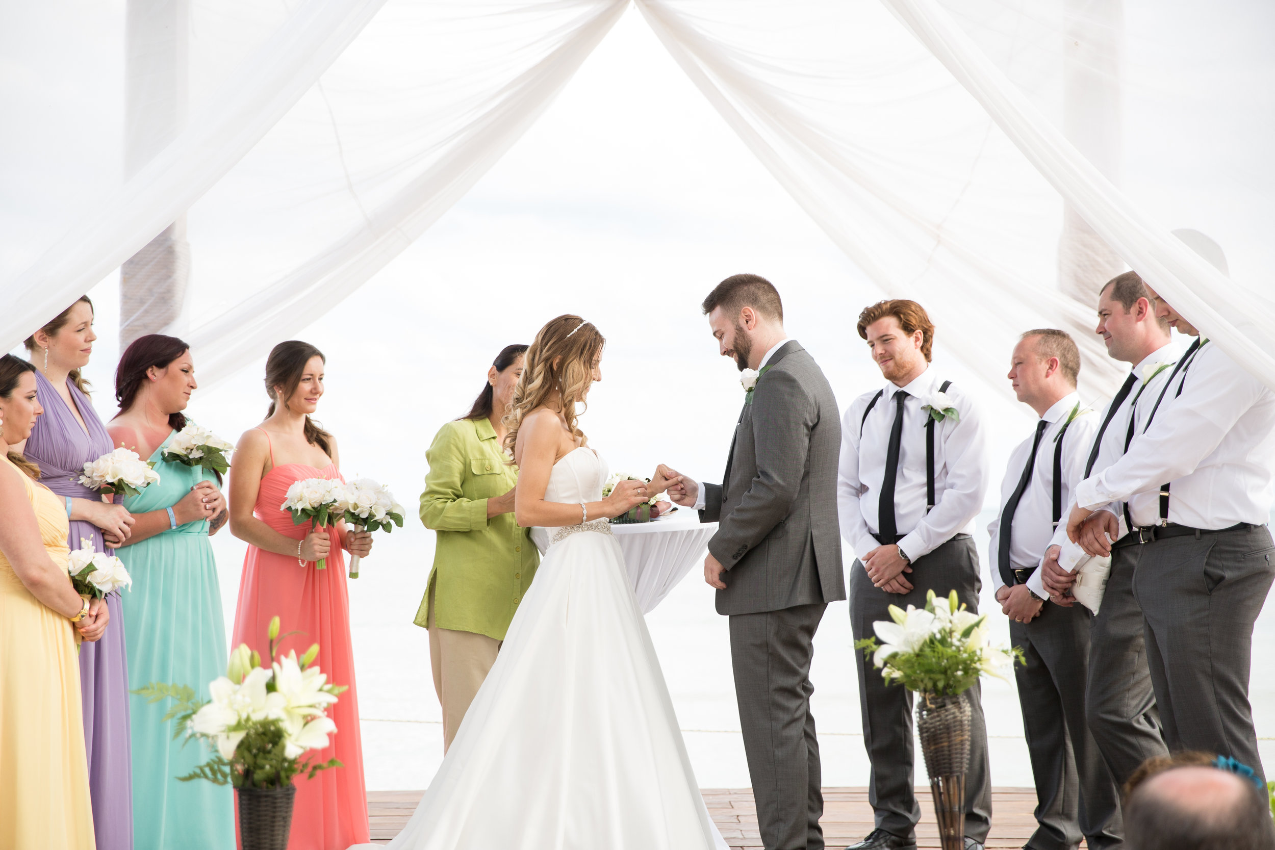 exchanging rings at beach wedding