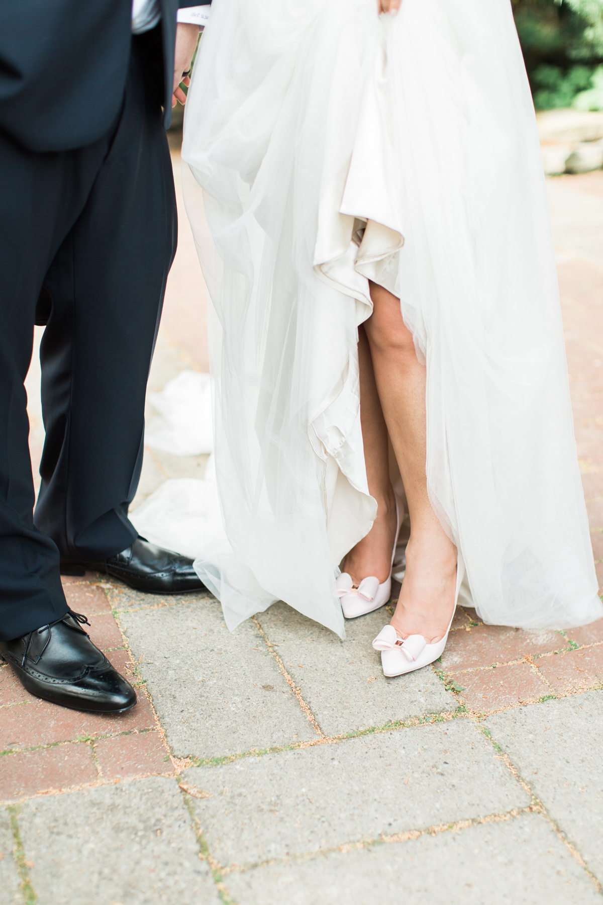 bride wearing pink wedding shoes