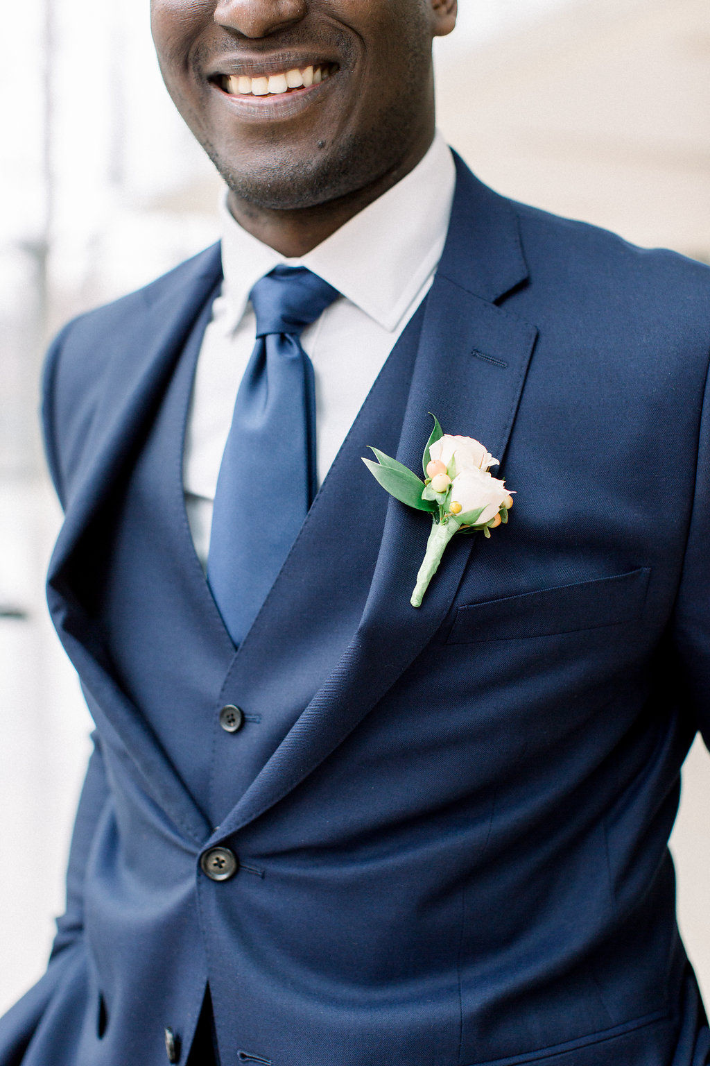 groom wearing a blue suit.