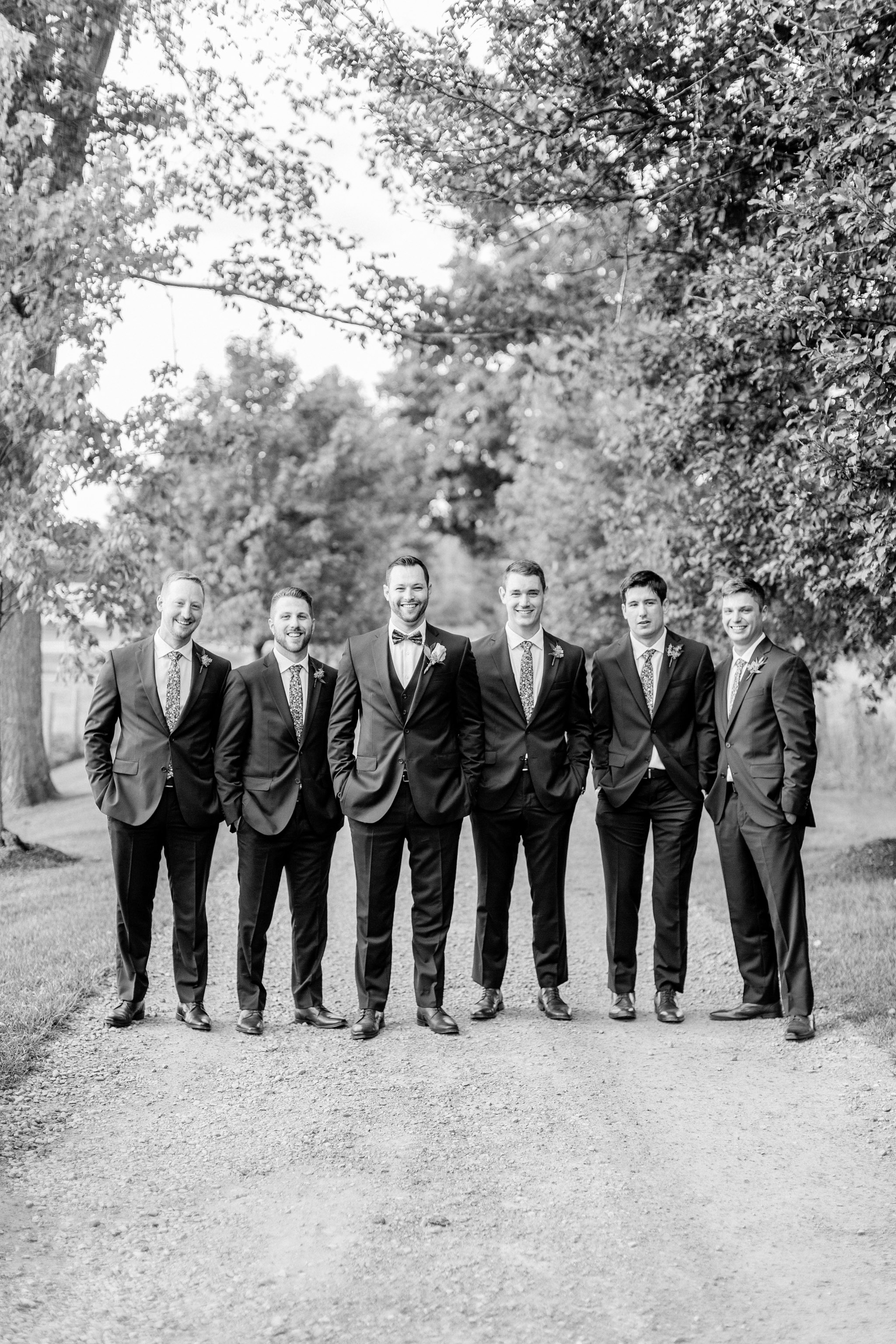 Groomsmen wearing navy blue suits.