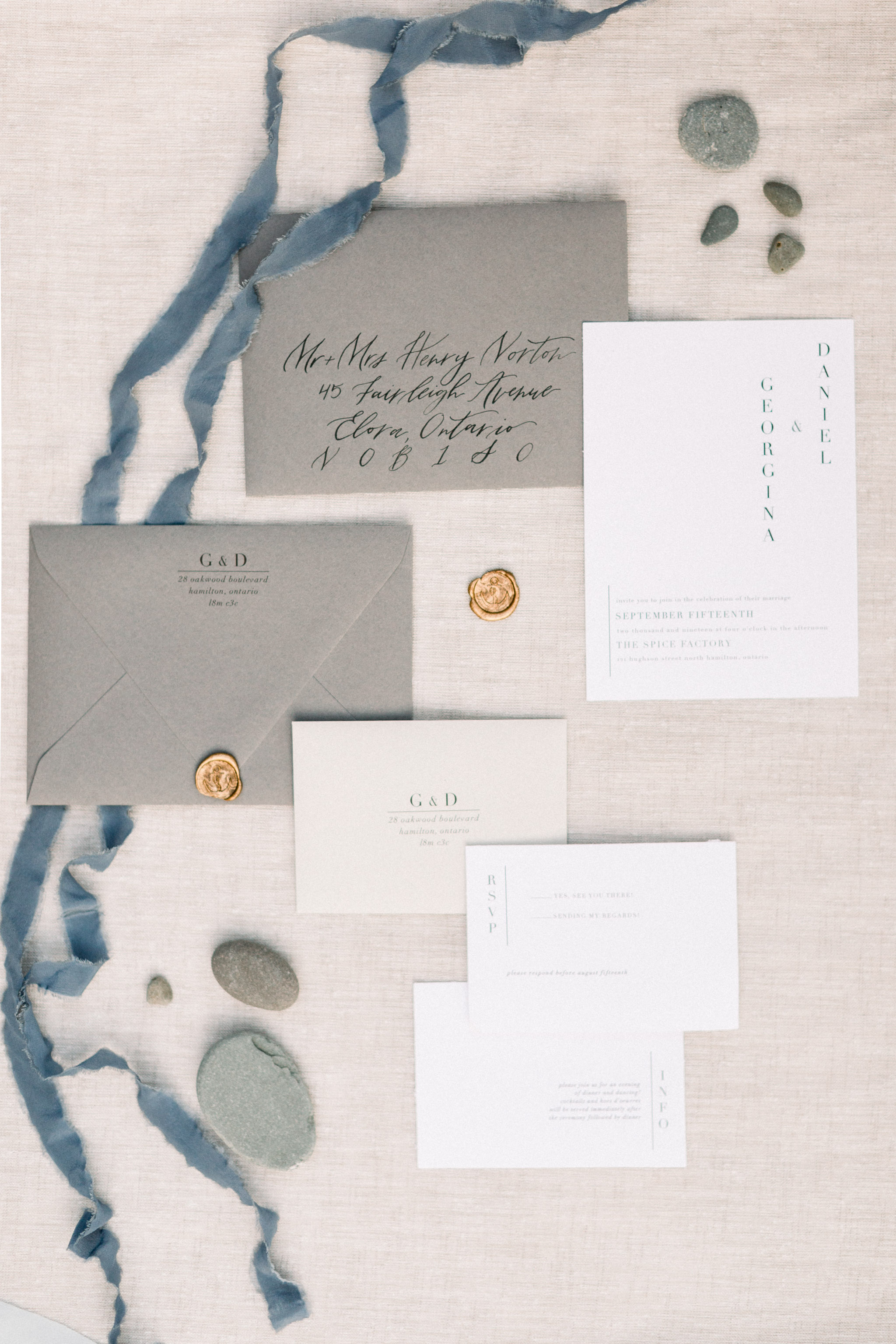 White and grey wedding invitations.