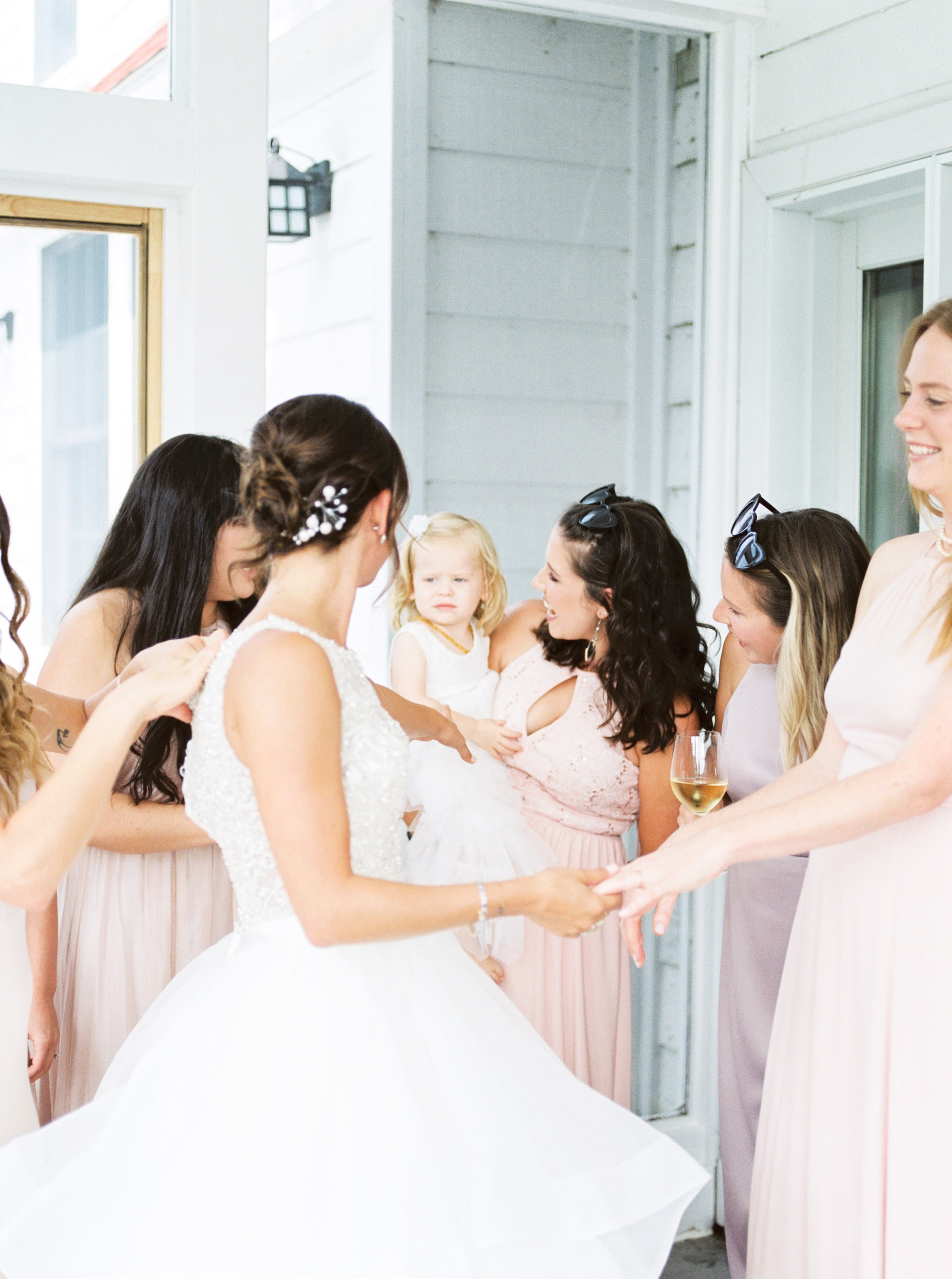 bridesmaids wearing pink dresses.