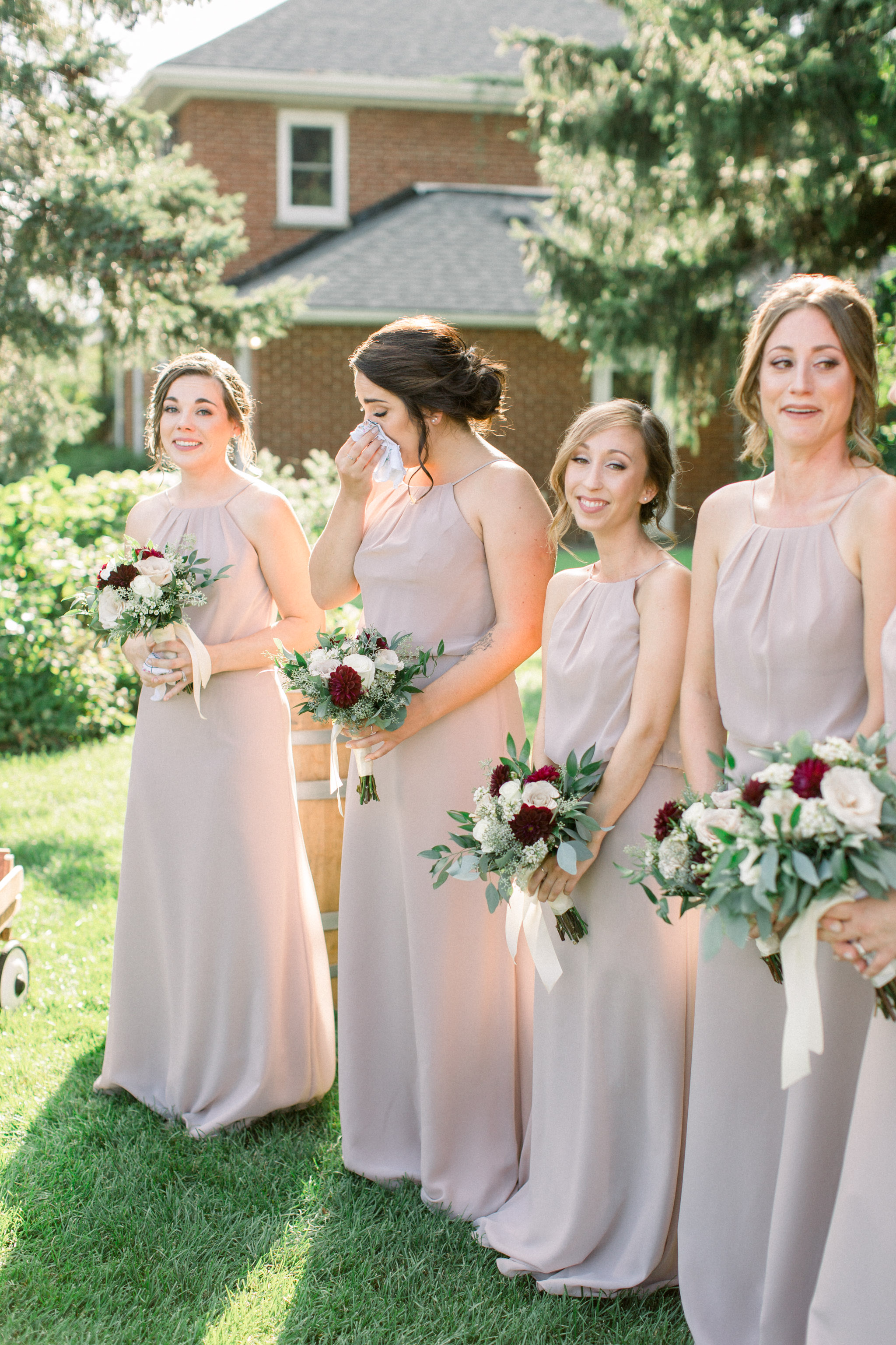 Bridesmaids crying during ceremony.