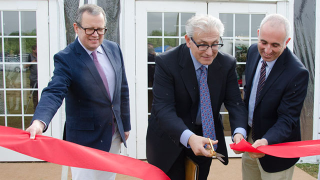 Rick Friedman (center) ribbon cutting ceremony opening the Hamptons Contemporary show