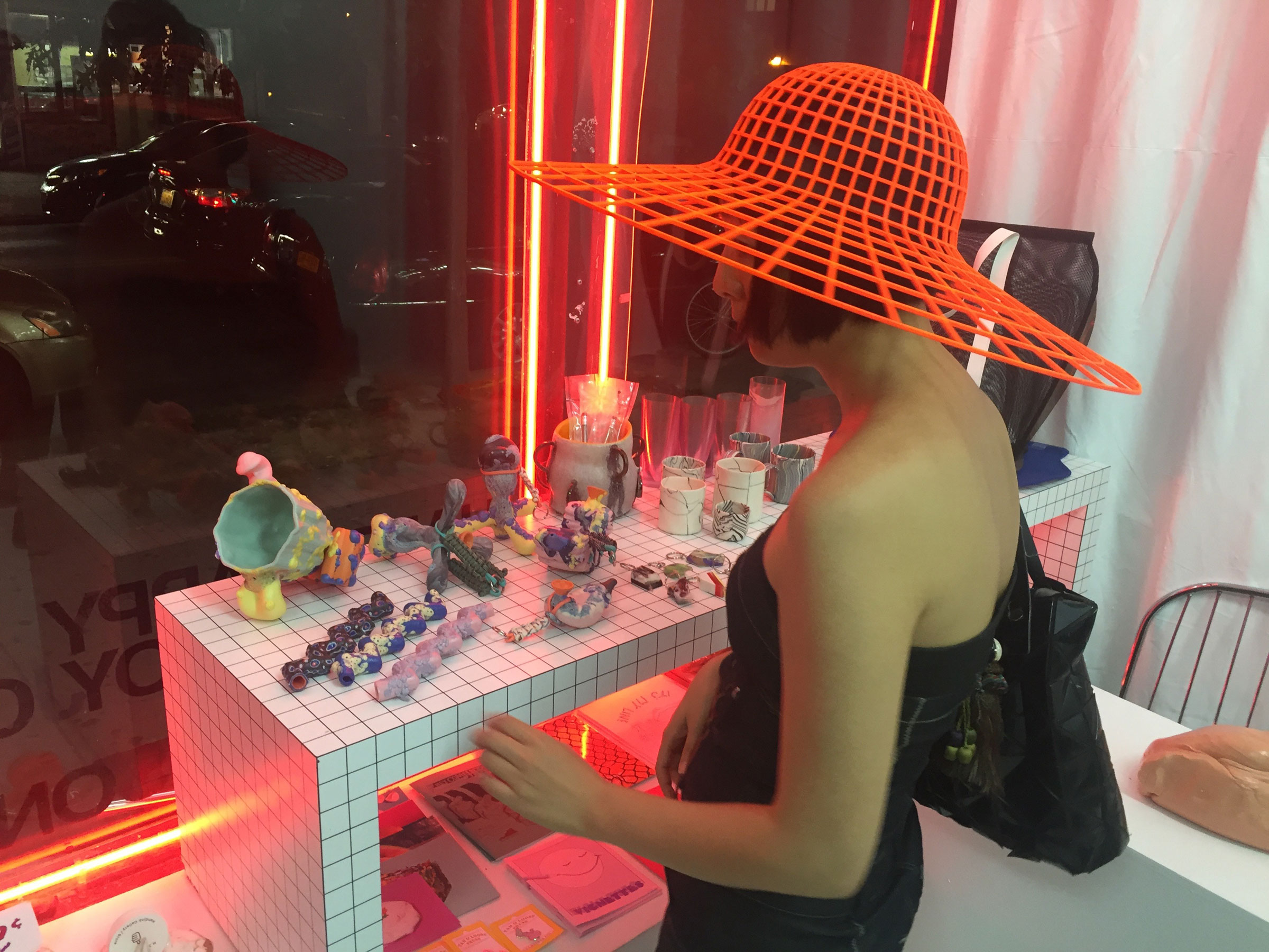 We attended the opening with hat designer Heidi Lee, pictured here with one of her creations