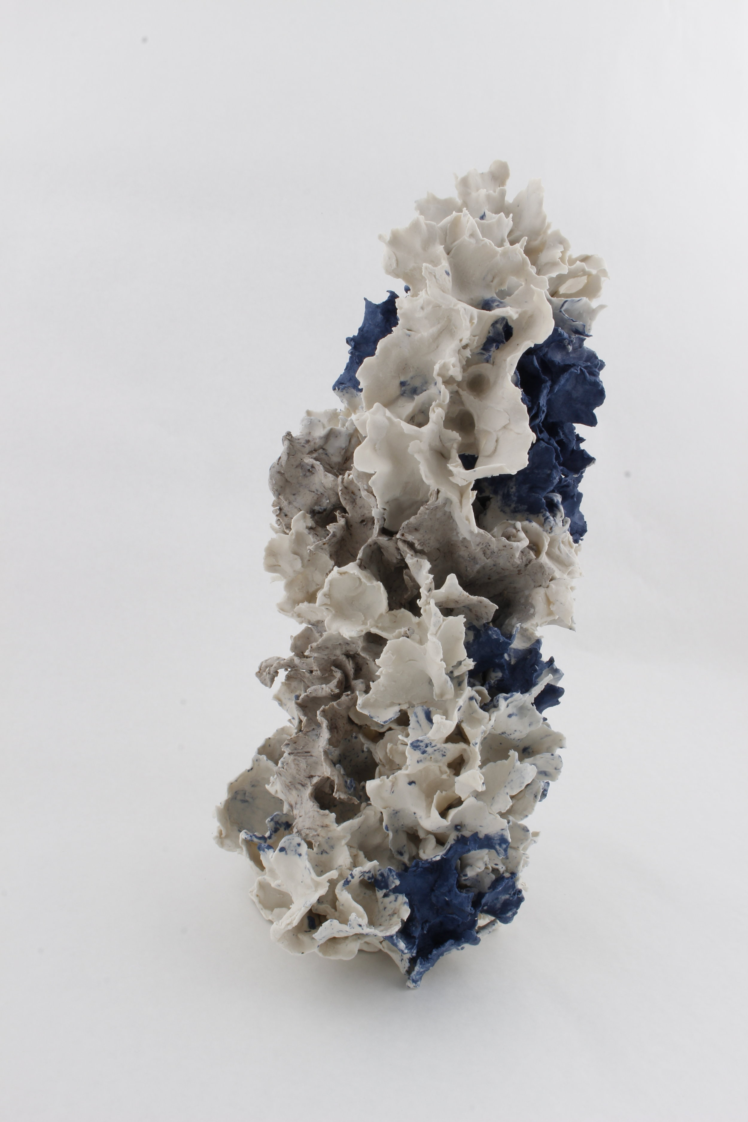 S imultaneous Growth , 2018. Paper clay, fire to cone 6, electric klin, 8 x 17 x 8 inch © Renqian Yang, courtesy Fou Gallery