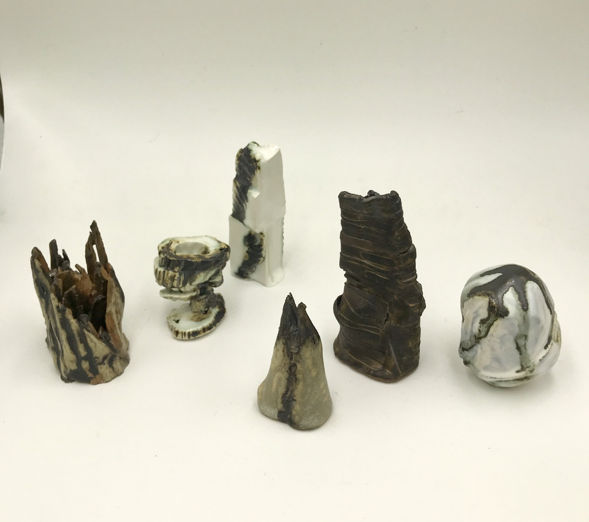 Hilda Shen,  Range of Mountains,  2014-2019. Glazed clay, a group of six, each around 2.75 x 2 x 2.25 inches, ©Hilda Shen, courtesy of Fou Gallery
