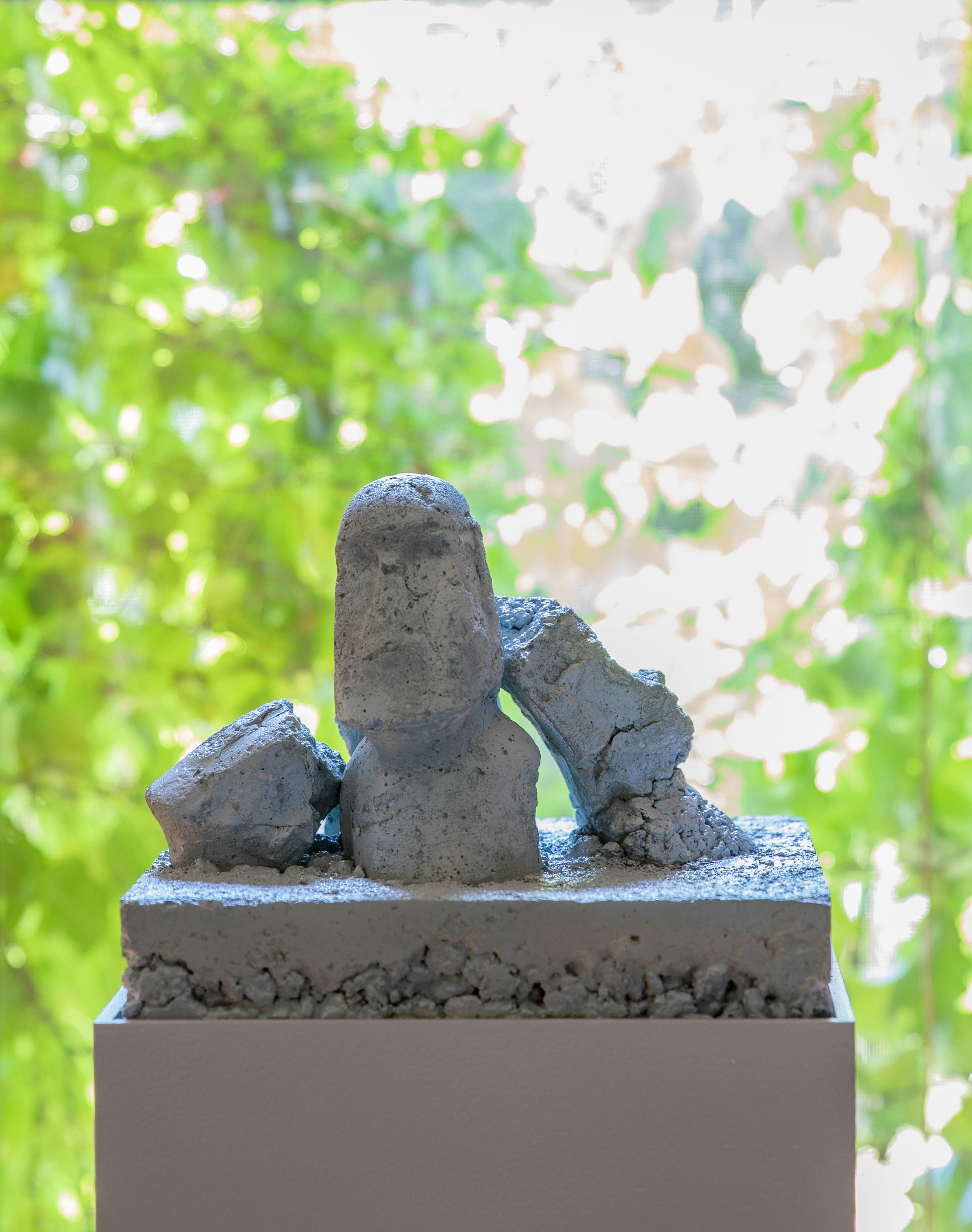 Siyuan Tan,  The Statues of Moai Were Destroyed in the Wild , 2018. Concrete, wood, 12 x 12 x 11 inch; Base: 35 x 12 x 12 inch ©Siyuan Tan, courtesy Fou Gallery