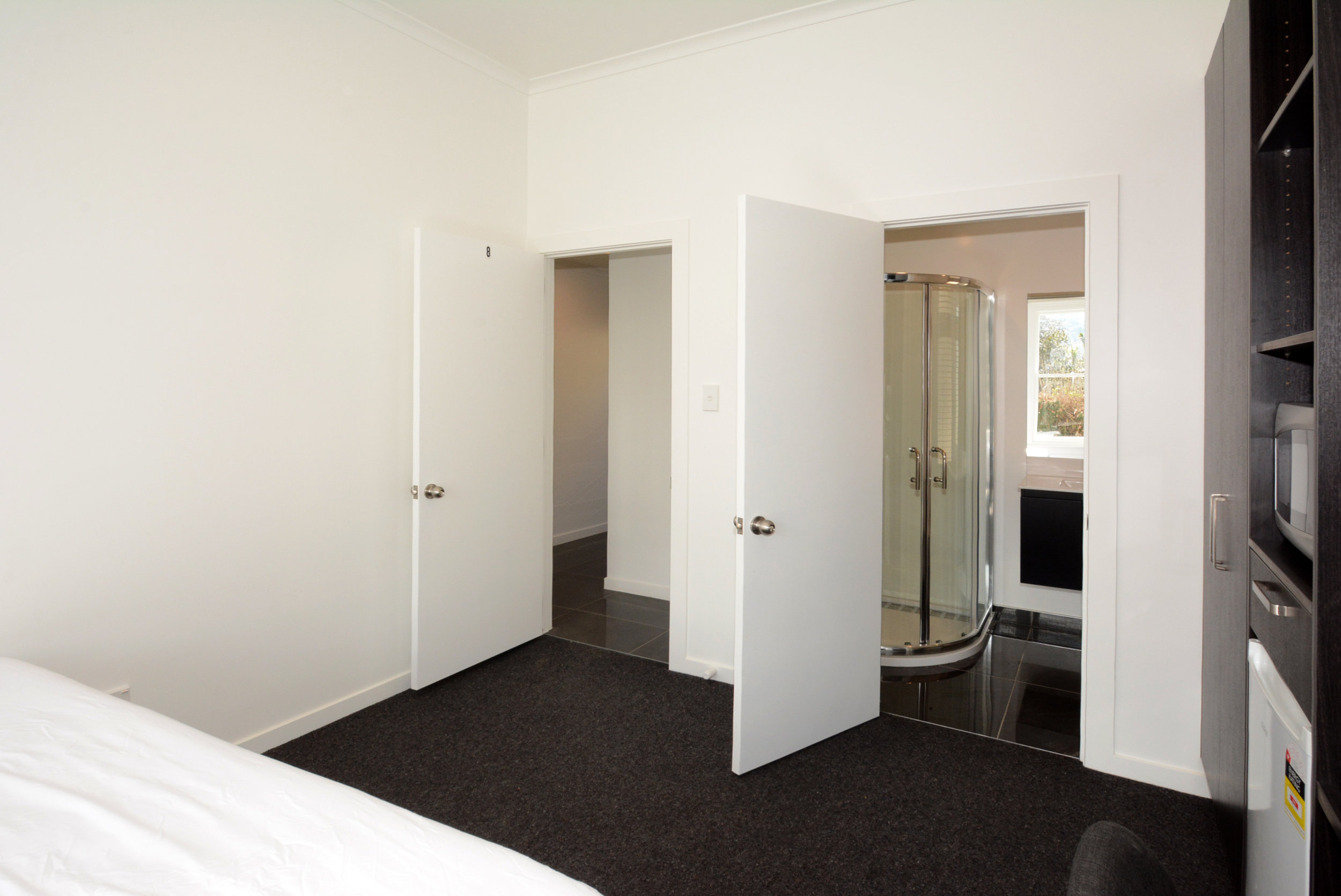 Execution Studio room entrance and ensuite bathroom