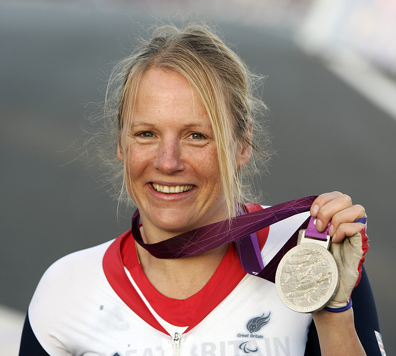Karen with the silver medal she won in the 2012 Paralympics.
