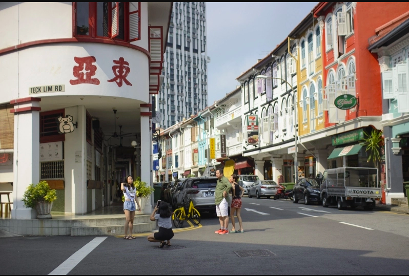 A common sight in Singapore's historic areas, shophouses abide by a strict set of building codes that can prohibit business owners from making structural changes such as installing ramp or lift access. (Image: Tripzilla)
