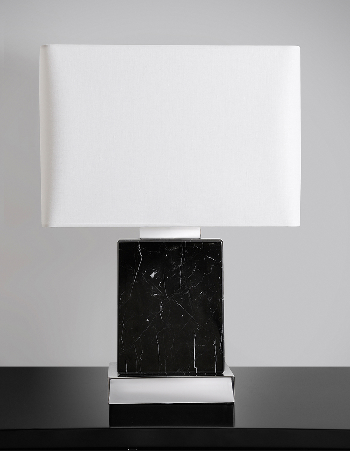 Handmade pure black marble w/ white veins and chrome details.
