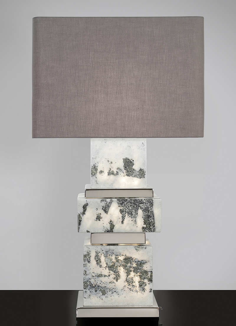 Triple illuminated handmade marble lamp with polished nickel details.