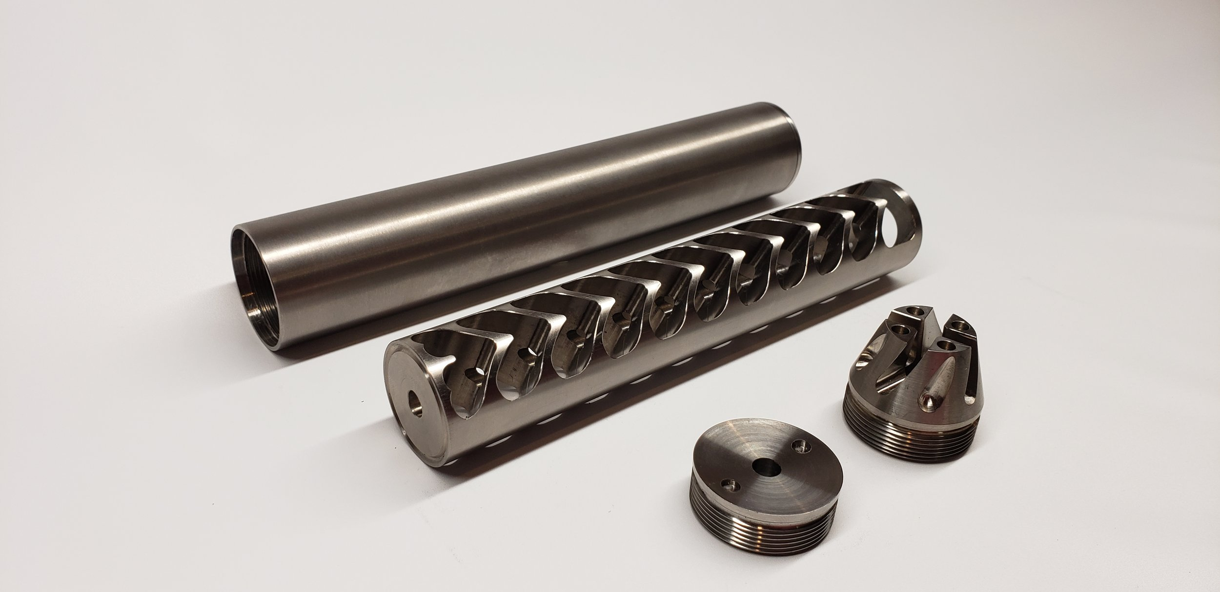 """223/5.56 Titanium - Shown with standard and optional tactical end cap Available in Titanium and Stainless Steel1.55"""" x 8.8""""1/2x28 Thread"""