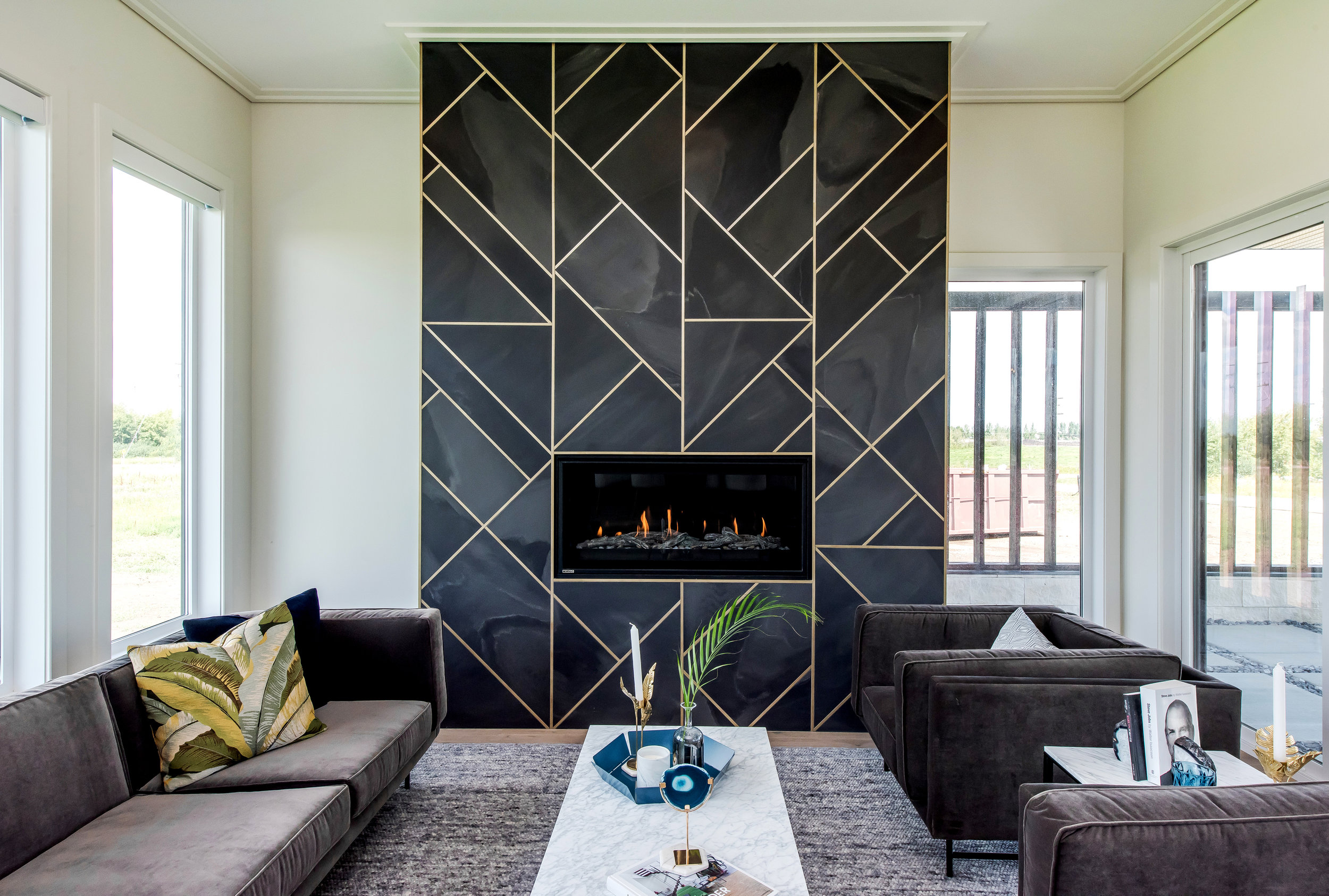 One of our favorite fireplace surrounds to date, this Hospital Home Lottery showhome in Greenbryre estates was the guinea pig for a design inspiration that was drawn from a powder room with great wallpaper