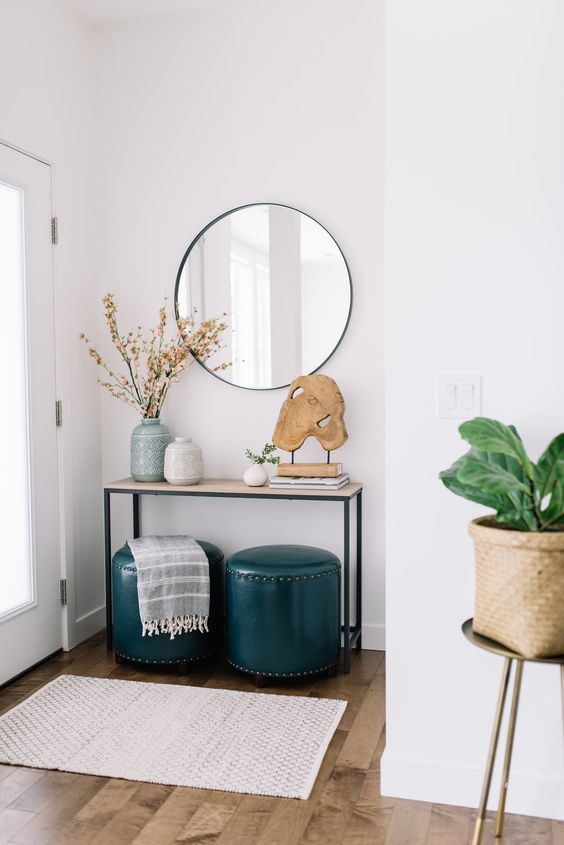 Adding a console table (if your space allows) is a great spot to have your key drop, mail basket, and a cheery succulent to greet you when you come home. Urban Barn and West Elm have some great options.