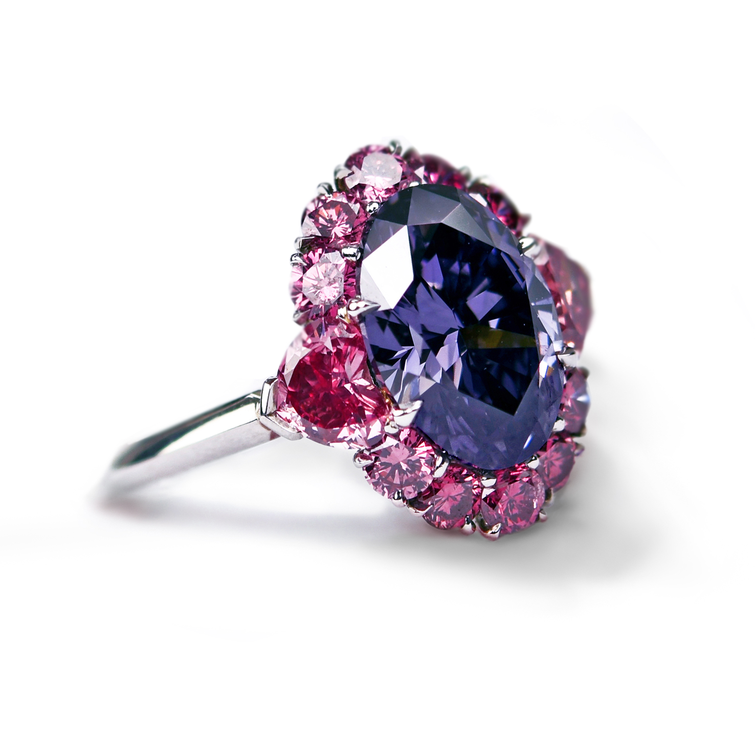 The impossibly rare 2.83 carat Argyle Violet diamond set in a masterful design accented with 12 incredible vivid pink diamonds. A true one of a kind jewel.
