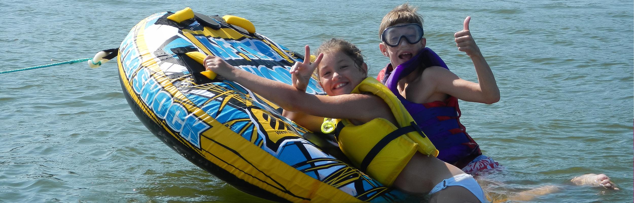 kids in a raft having fun