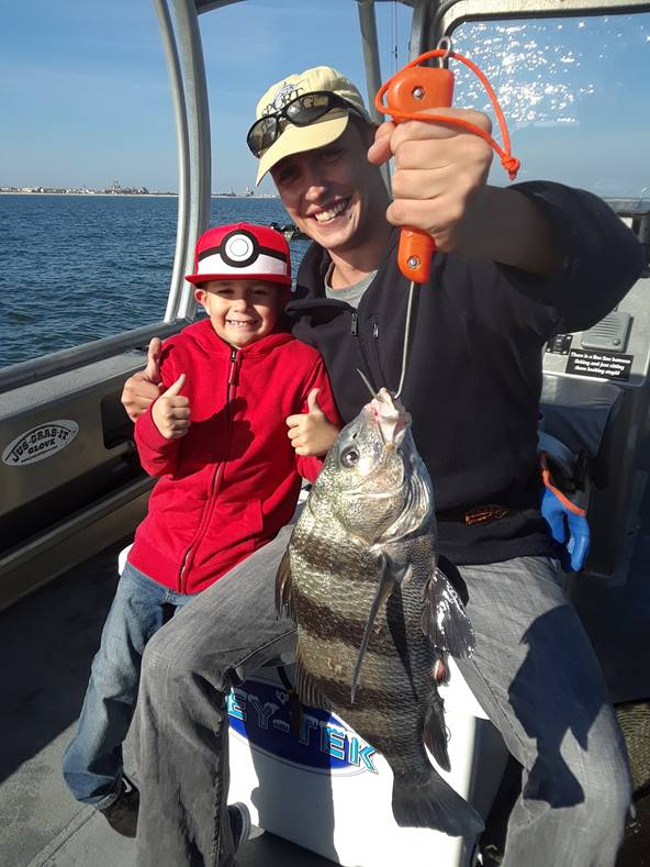 kid and his sheepshead catch