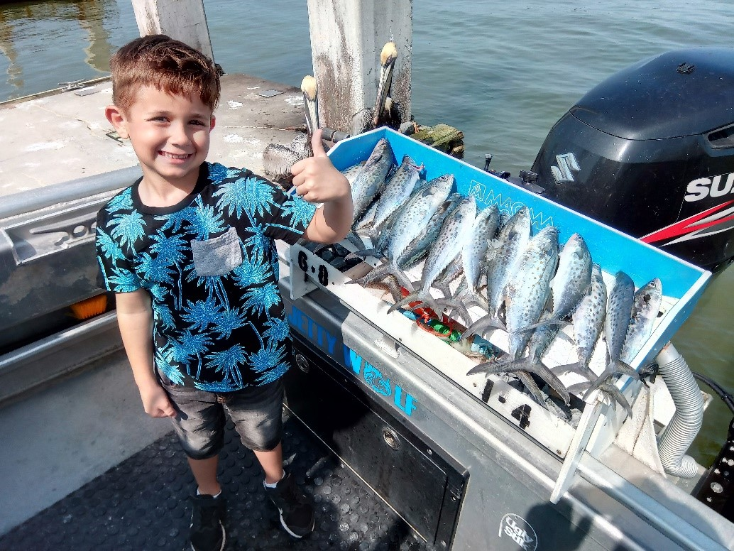 Young Jacksonville fisherman with his Spanish Mackerel catch