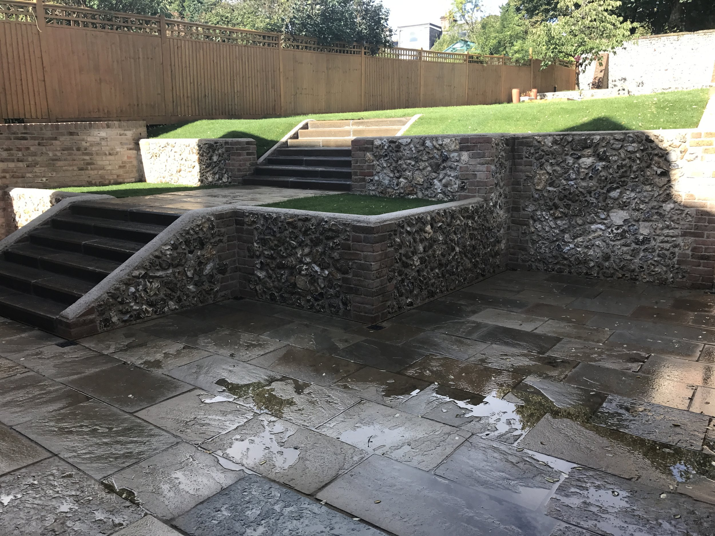 After - reclaimed York stone terrace and flint walled garden