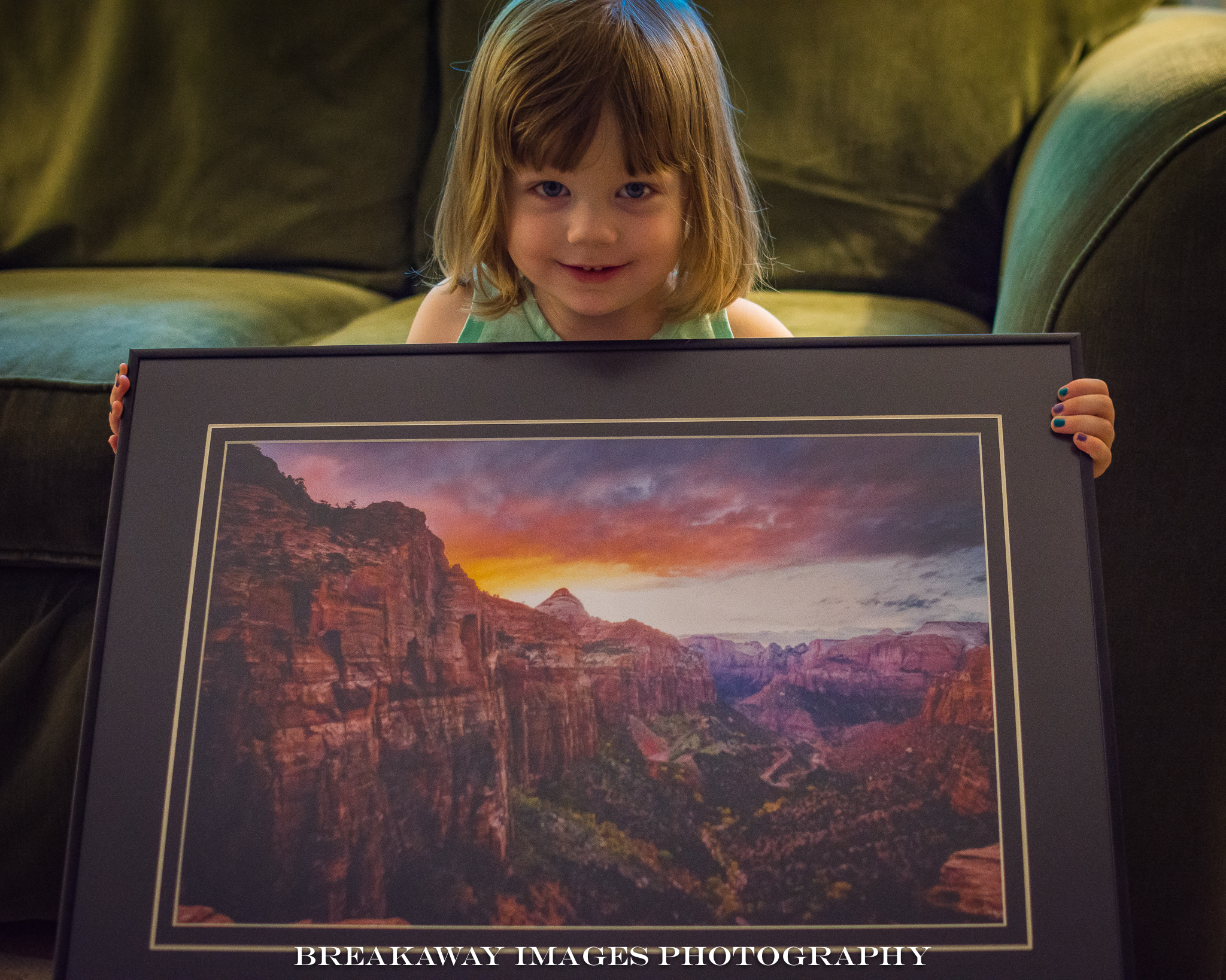 "Emma holding ""Sunset at Zion National Park"""