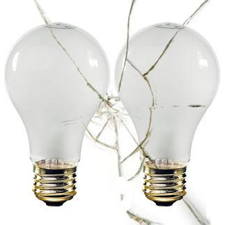 Rough service shatter resistant incandescent light bulb