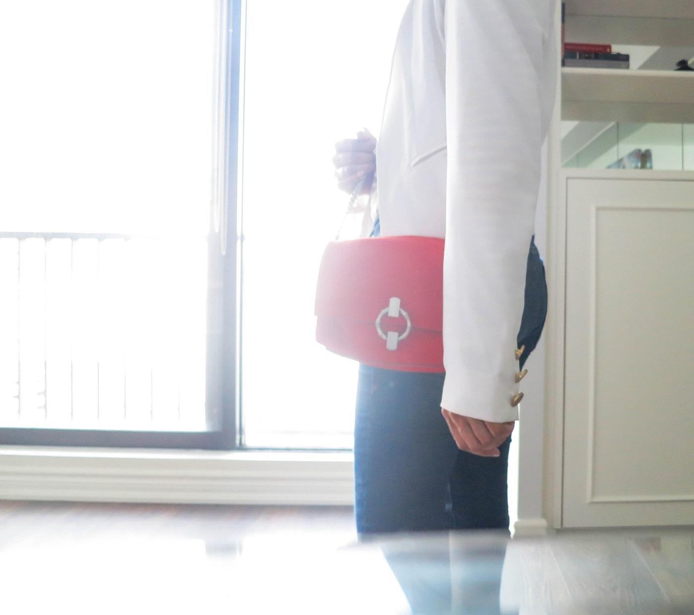 orange purse with neutrals
