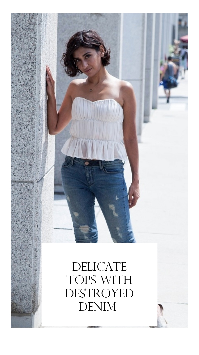 delicate tops with destroyed denim
