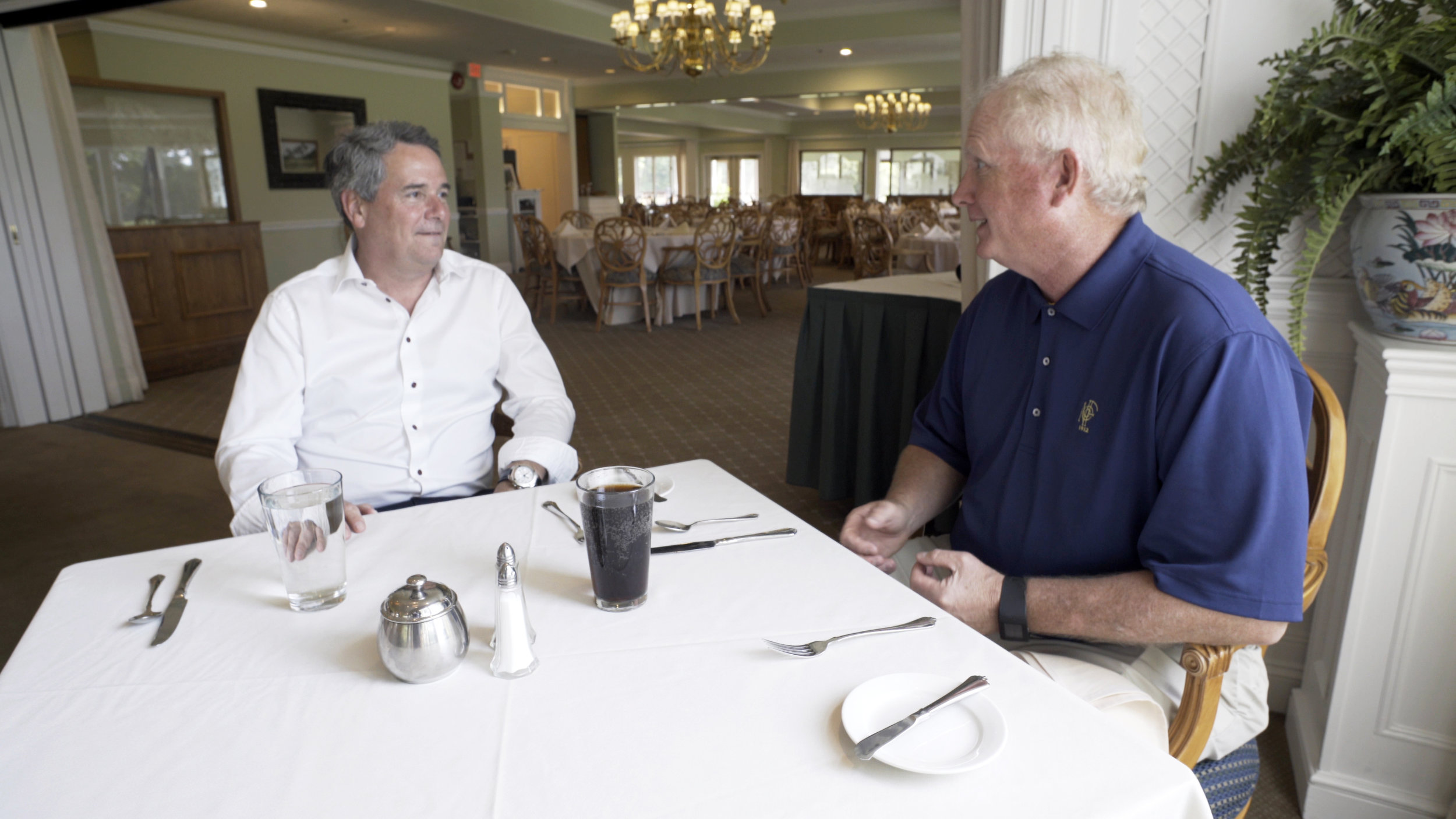 Kevin meeting with a client over lunch.