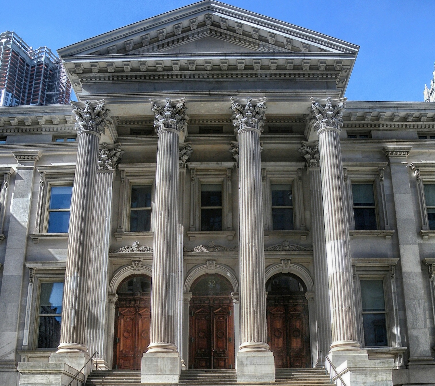 Stately looking stone building with four large stone columns.