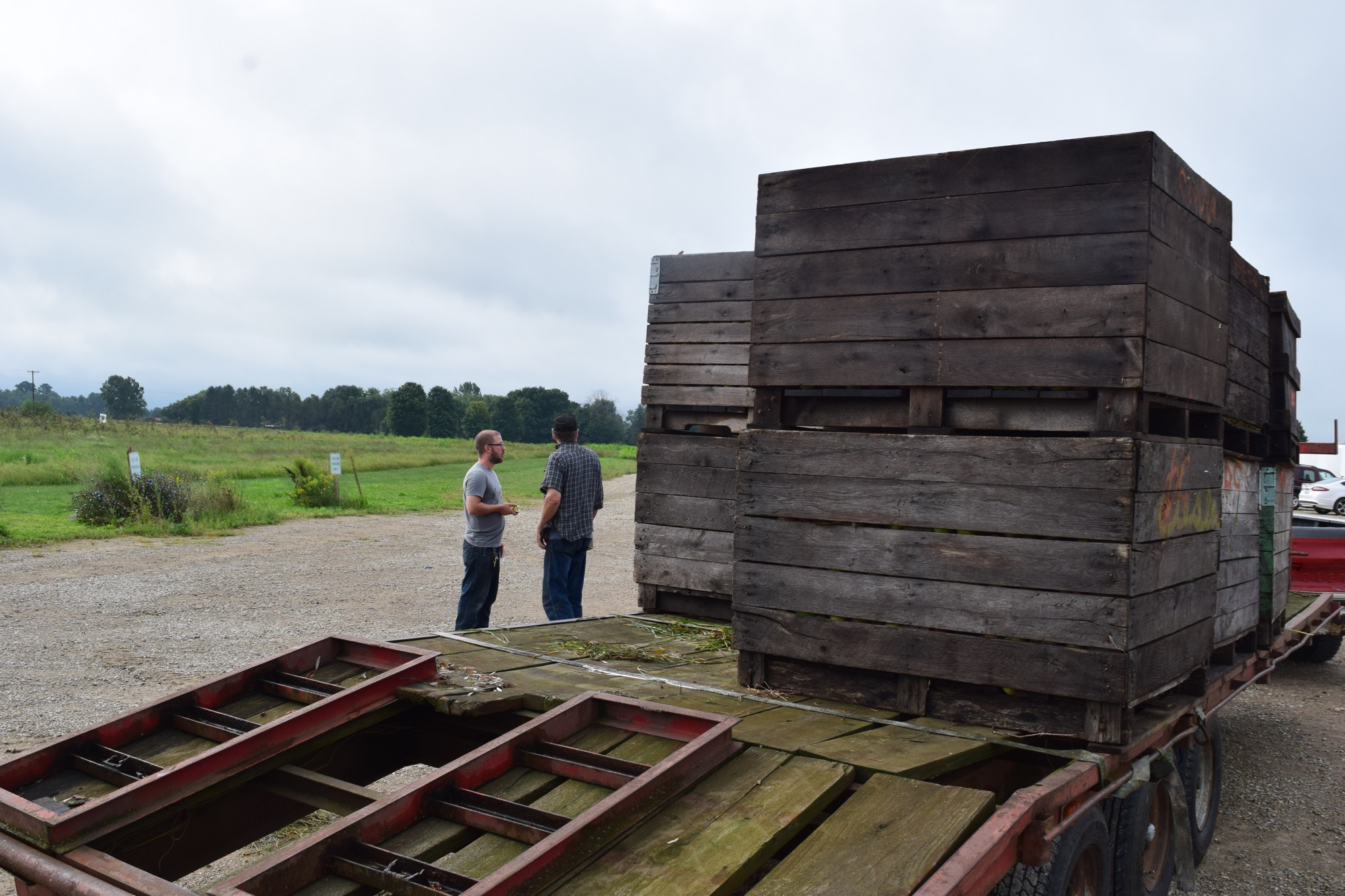 Head Cidermaker Seth Boeve chats with a farmer about his apple delivery.