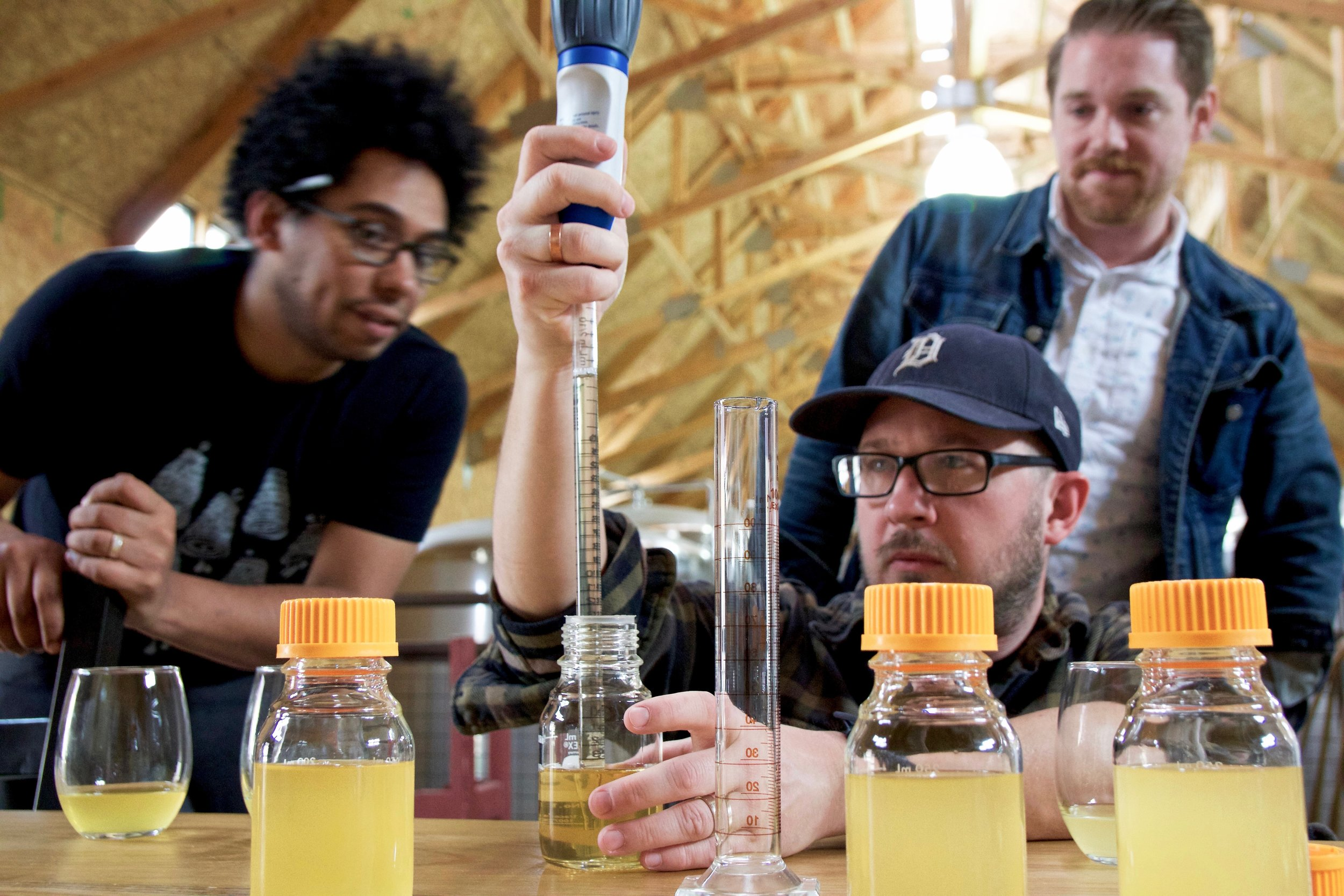 Seth pulls cider from a sample bottle to blend the right ratio of flavors for Garage Core.