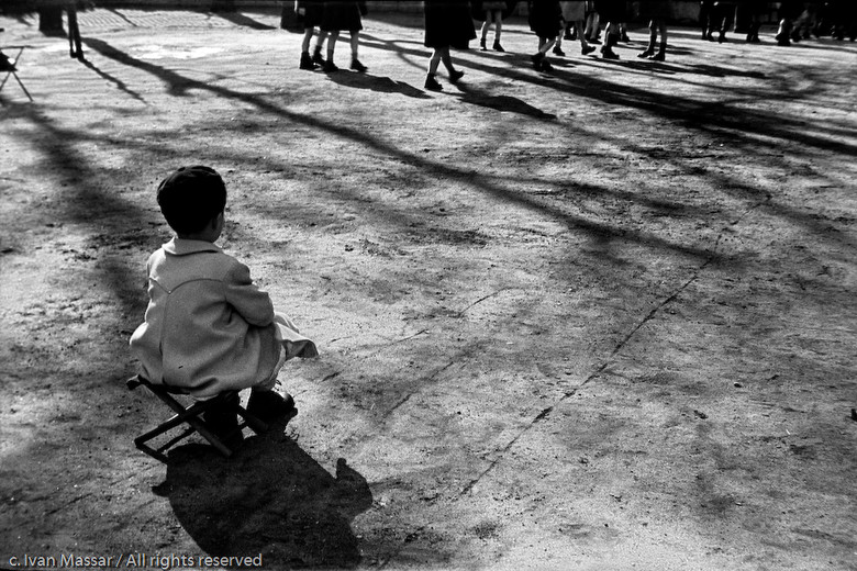 Young child watching others go to school, Luxembourg Gardens.