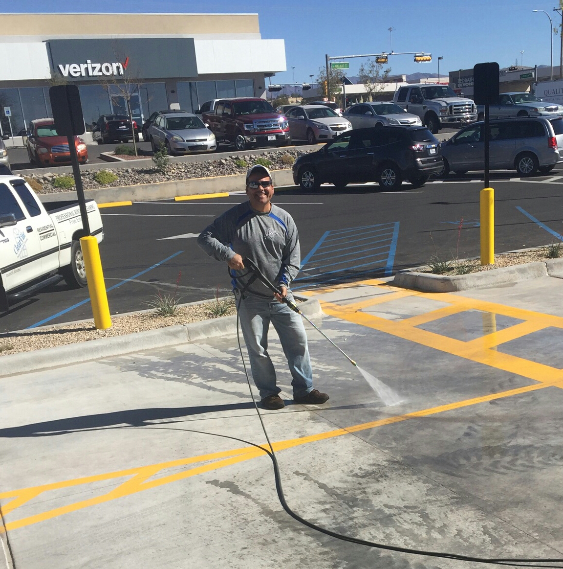 Peter Cruz, owner pressure washing concrete for a parking lot
