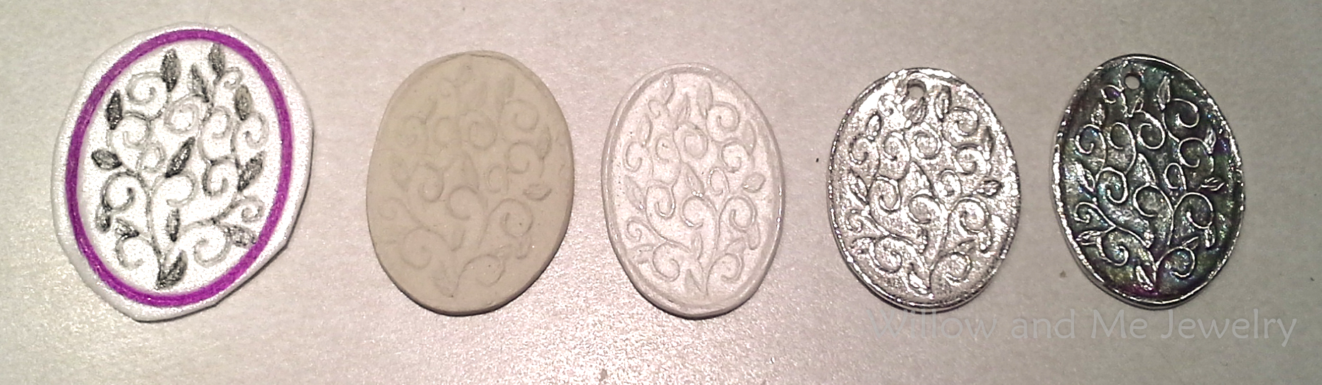 "The progression of work with PMC, from left to right:  A hand drawn texture; clay in the pre-fired ""greenware"" state; fired clay just out of the kiln; after tumbling; after antiquing with liver of sulfur."