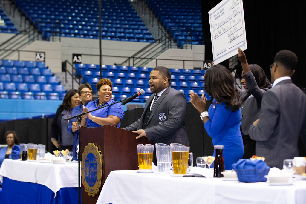 Gary, along with his Co-Lead, Courtney Upendo, presenting the 2018 class' record-setting gift of $42,000 toward Hampton University Scholarships.